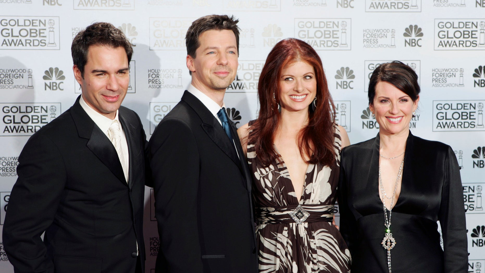 """In this Jan. 16, 2006 file photo, cast members from the comedy series """"Will & Grace,"""" from left, Eric McCormack, Sean Hayes, Debra Messing and Megan Mullally, pose backstage after making an award presentation at the 63rd Annual Golden Globe Awards in Beverly Hills, Calif."""