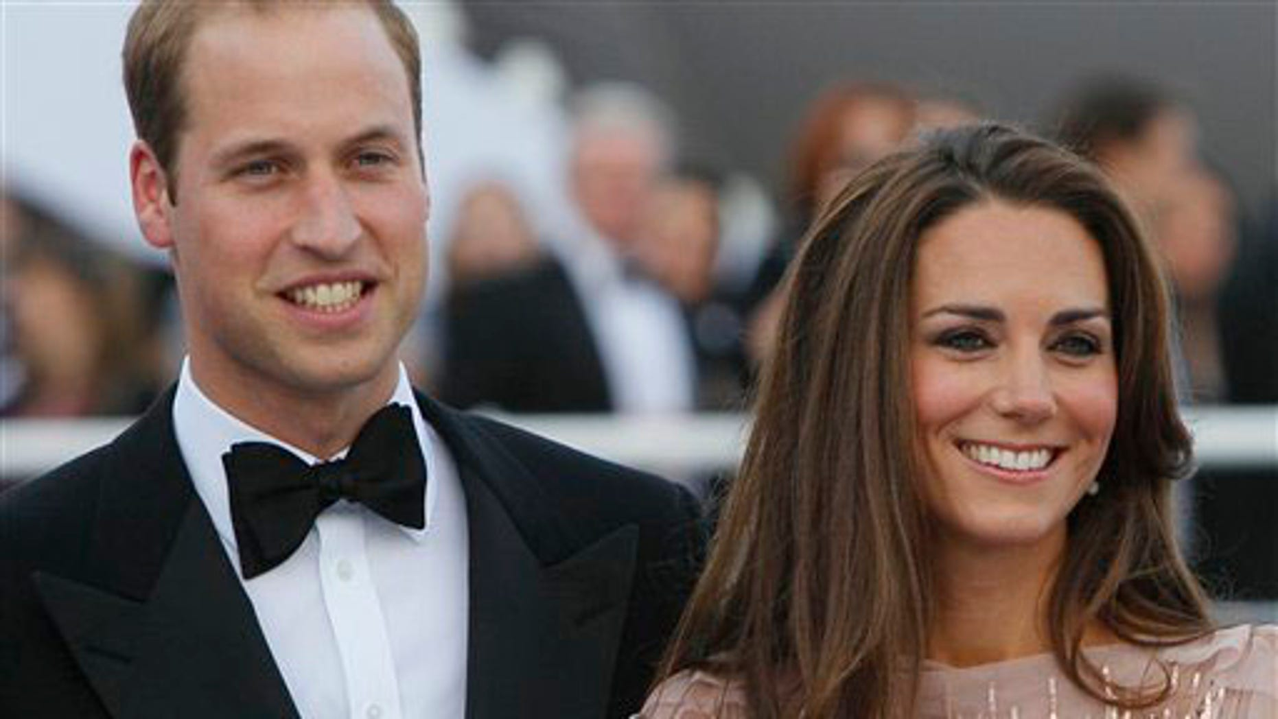Prince William and his wife Kate, Duchess of Cambridge arrive at a charity event for Absolute Return for Kids, ARK, in central London, Thursday, June, 9, 2011. The charity event is the first official engagement for the couple since they were married on April 29.(AP Photo/Alastair Grant)