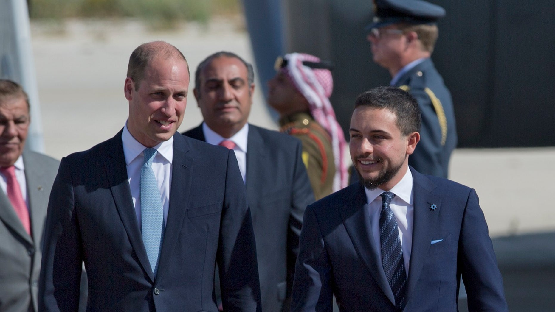 Britain's Prince William with Jordanian Crown Prince Hussein at Marka Airport in Amman, Jordan, on Sunday.