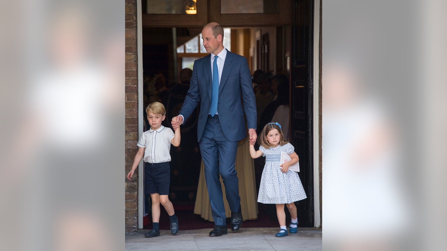 Britain's Prince William with his children Prince George and Princess Charlotte leave after the christening service of Prince Louis at the Chapel Royal, St James's Palace, London, Monday, July 9, 2018. (Dominic Lipinski/Pool Photo via AP)