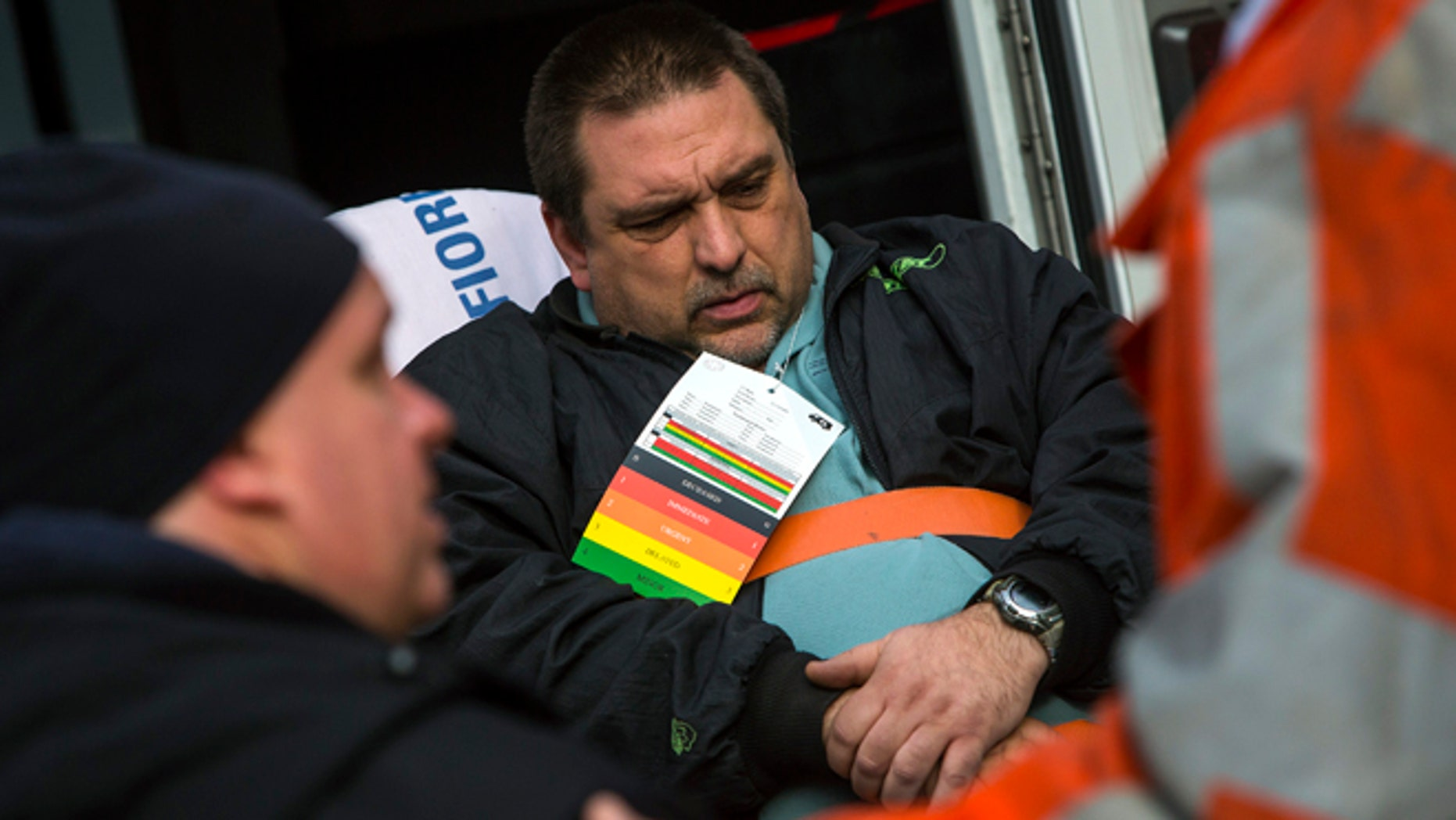 Dec. 1, 2013: Metro-North engineer William Rockefeller is loaded into an ambulance after a train derailment in the Bronx borough of New York.