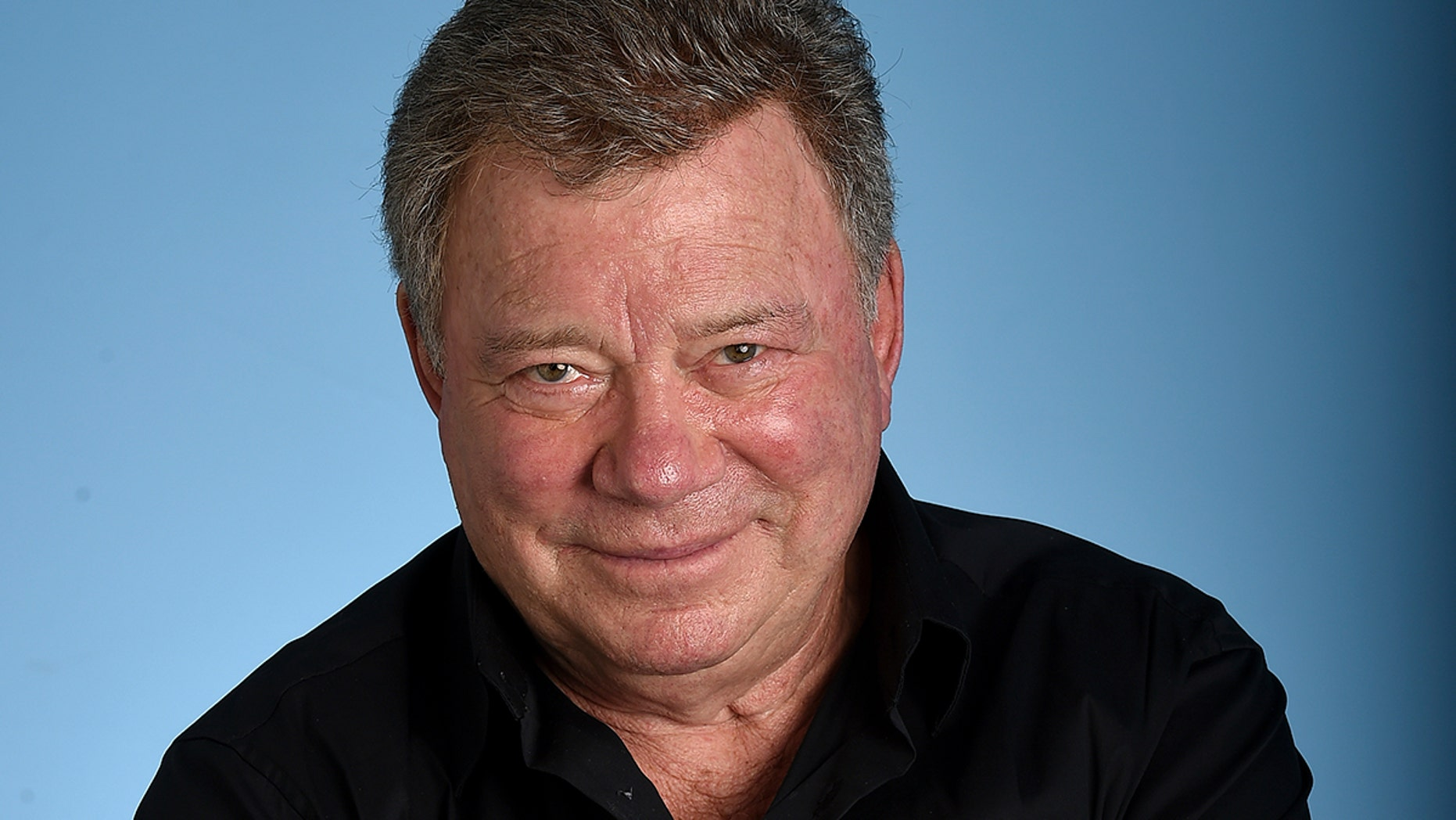William Shatner asked Facebook for an explanation after a fan noticed it was promoting a false article about his death.