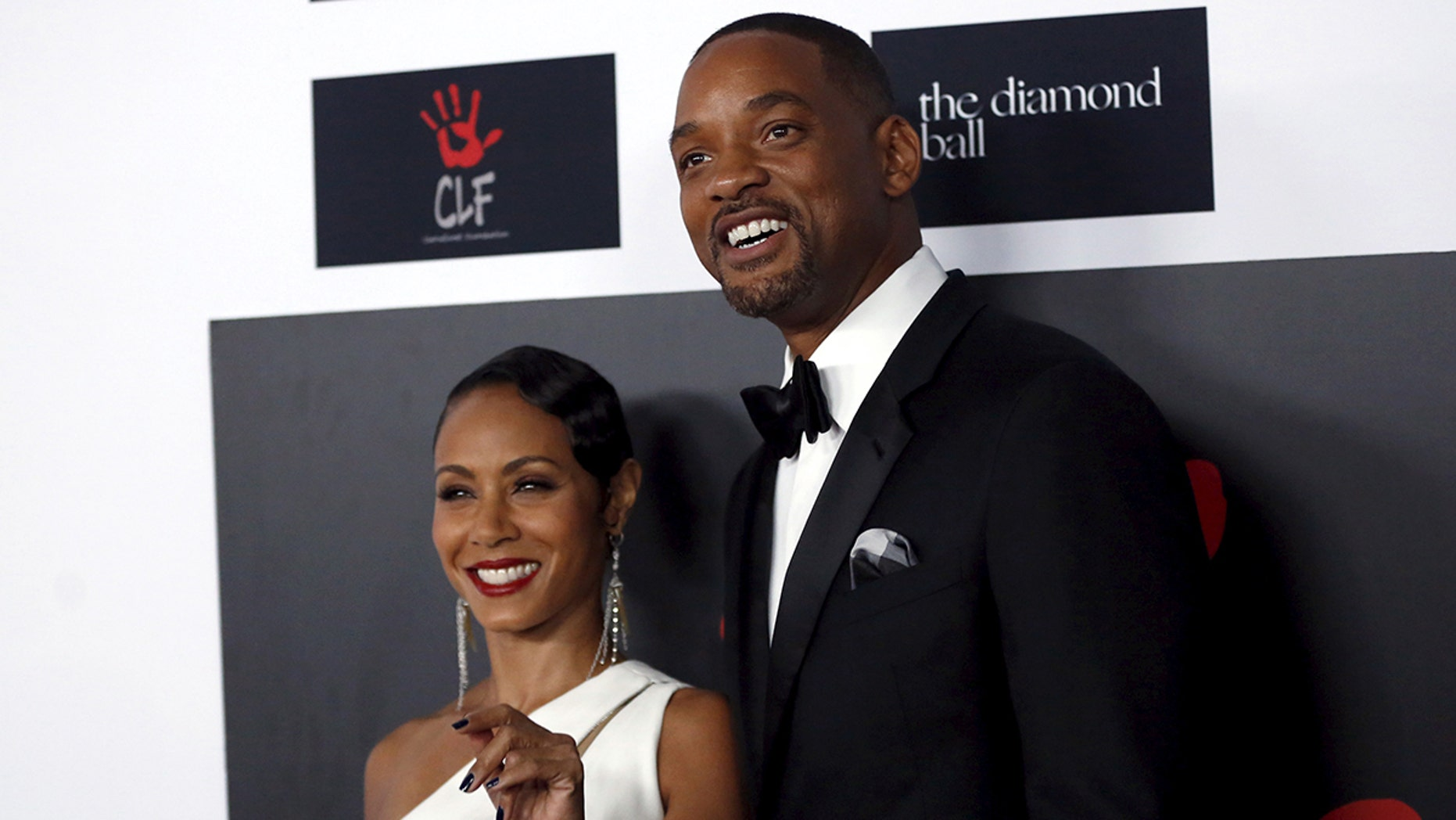 Actor Will Smith and his wife, actress Jada Pinkett Smith pose at the second annual Diamond Ball fundraising event in Santa Monica, California December 10, 2015.  REUTERS/Mario Anzuoni - GF10000262061
