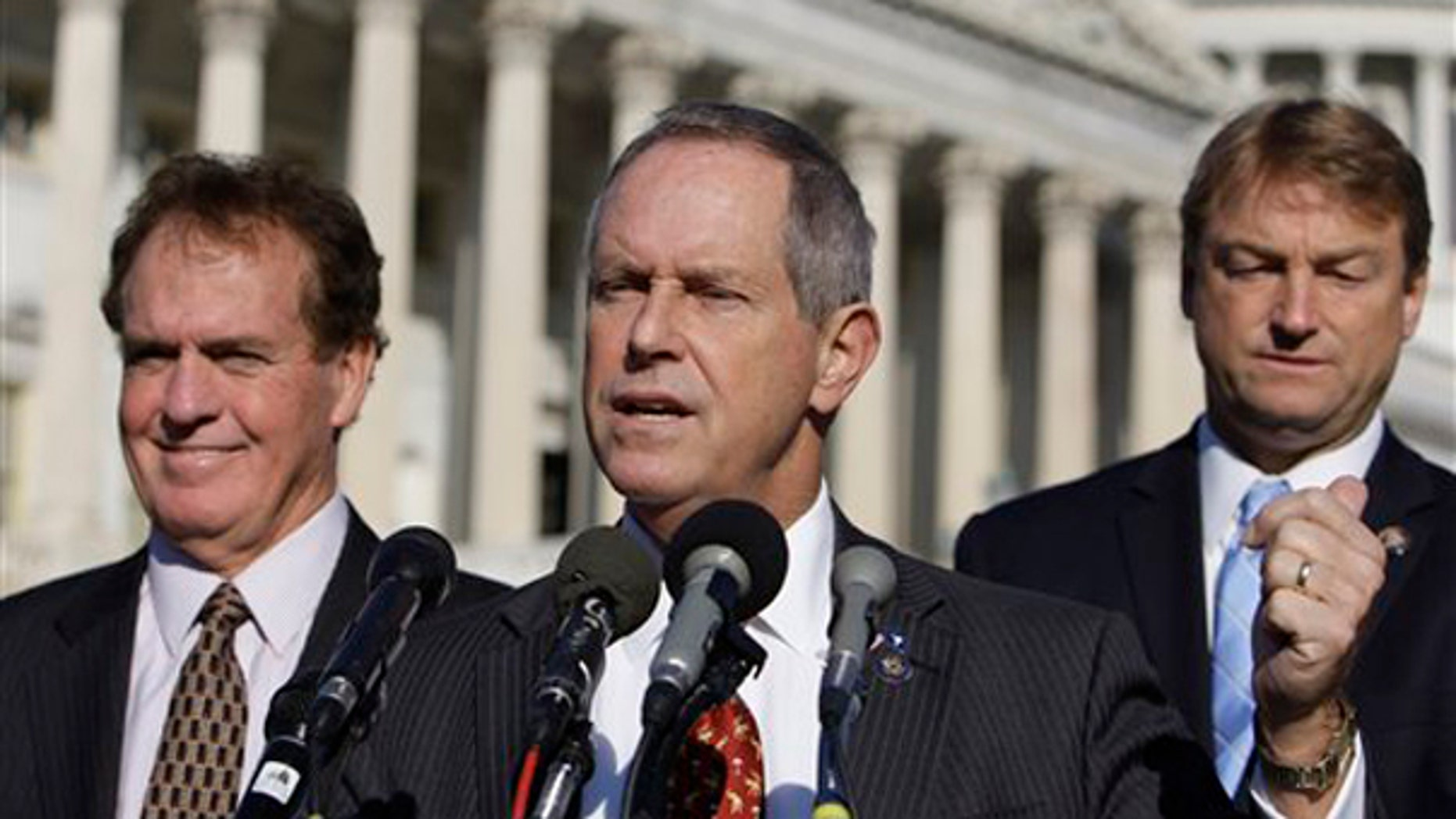 Rep. Joe Wilson, R-S.C., center, speaks about health care reform Nov. 4 in Washington, by Rep. Phil Gingrey, R-Ga., right, and Rep. Dean Heller, R-Nev. (AP Photo)