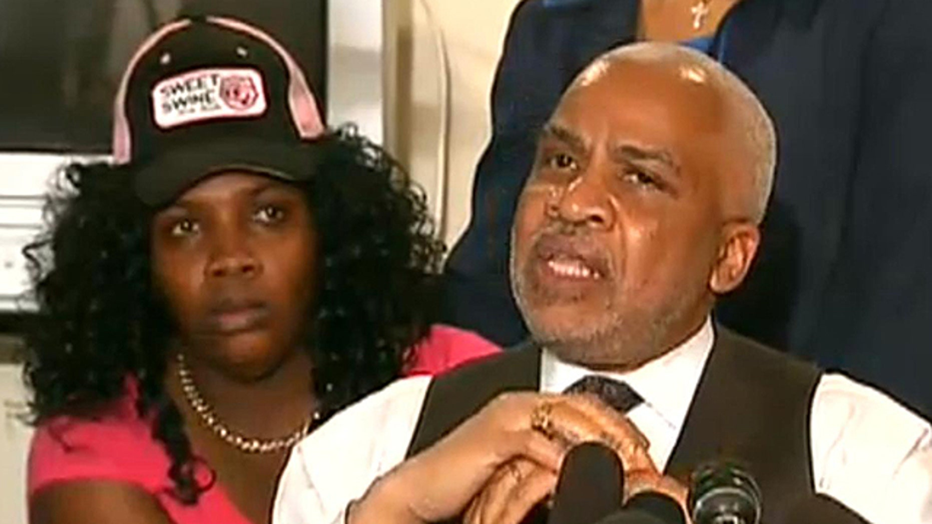 """""""I have not seen the ticket, nor do I want to see the ticket,"""" said attorney Edward Smith, right, as Marlinde Wilson stood behind him."""