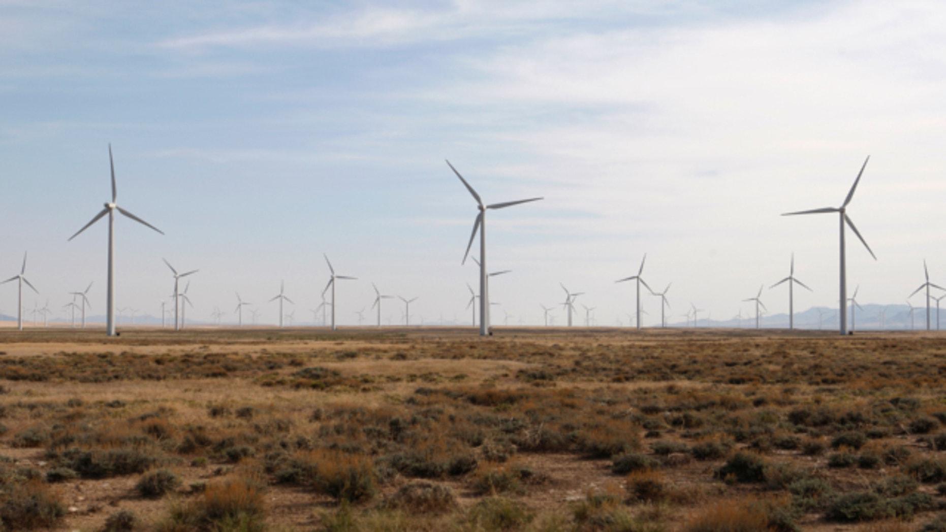 May 21, 2012: Wind turbines operate at a wind farm near Milford, Utah.