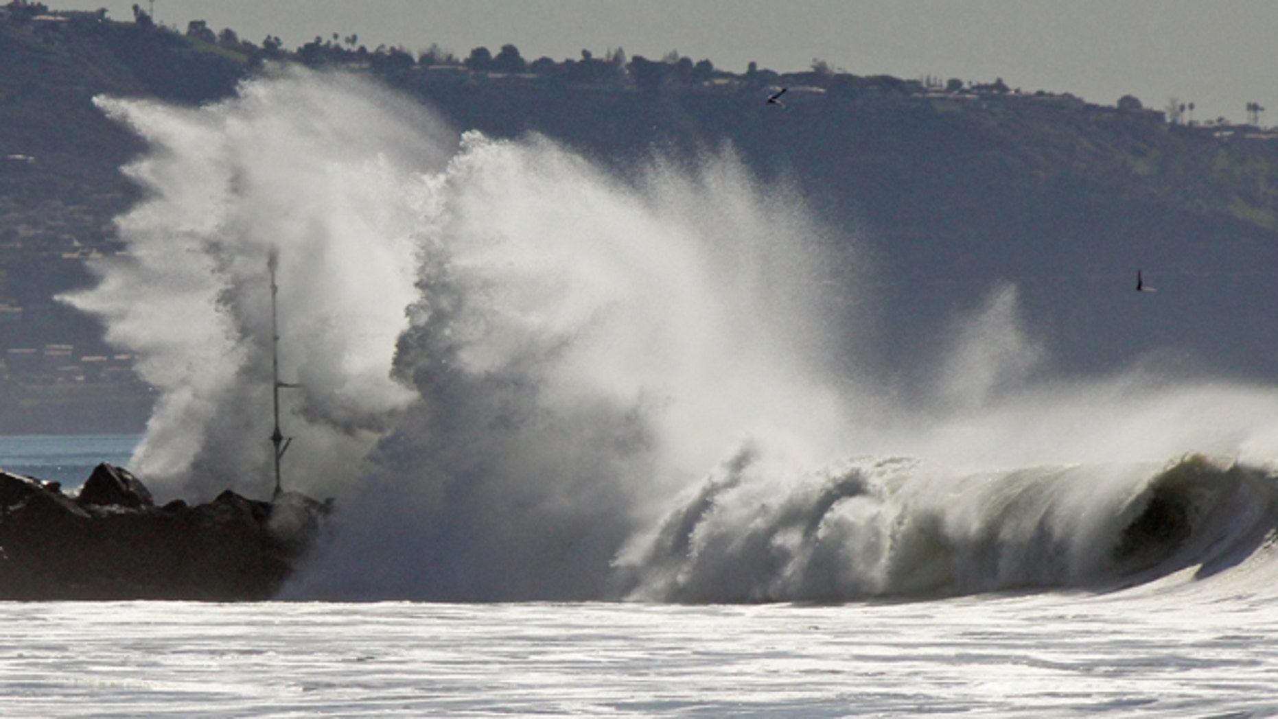 Jan. 24, 2015: Huge surf crashes over a jetty at El Segundo, Calif. (AP)