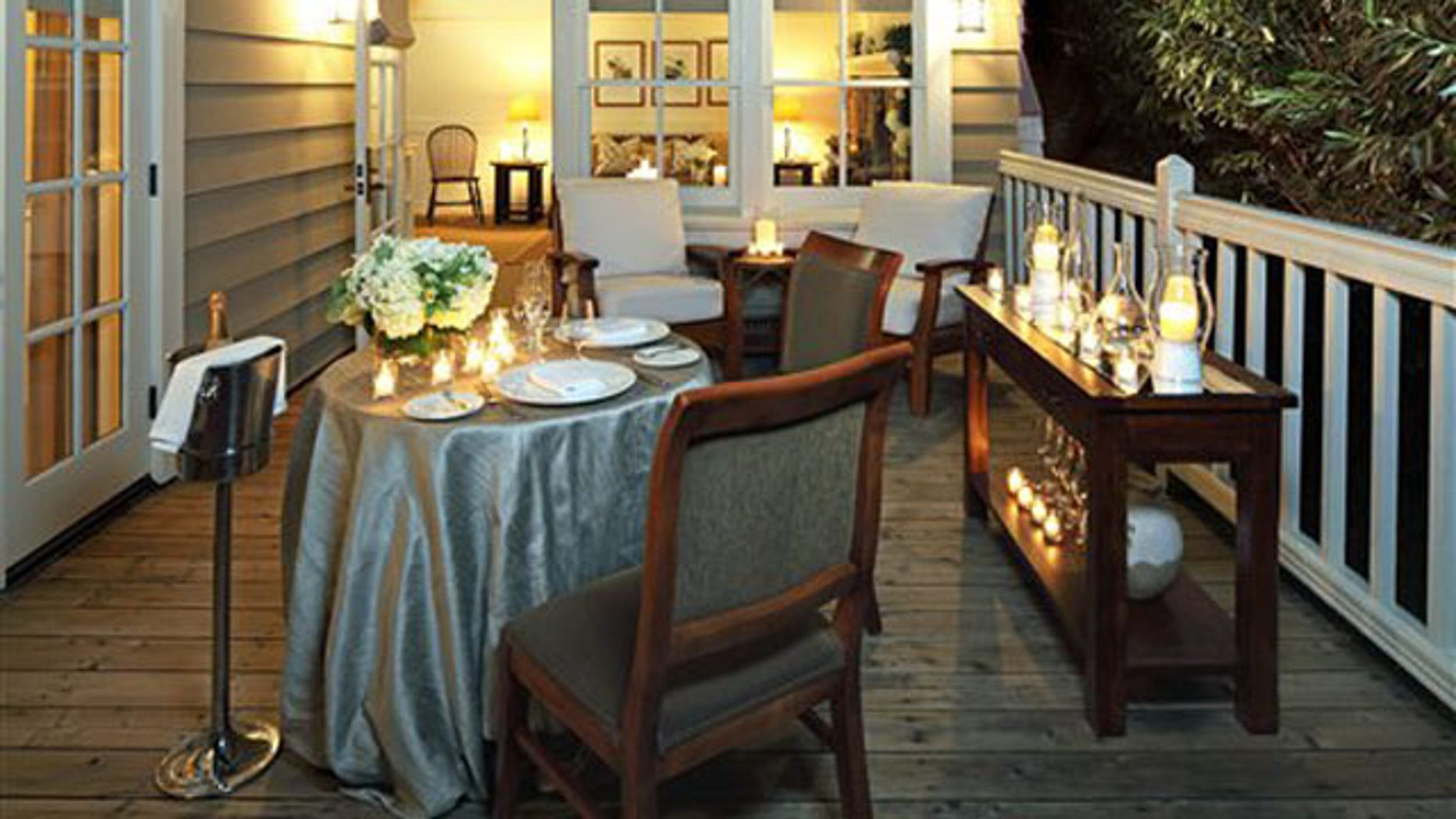 """This photo courtesy of Meadowood Napa Valley shows the Meadowood Club Suite deck in St. Helena, Calif. The exclusive Meadowood resort offers a """"We Hope Youll Elope"""" package. They provide the candles, decorations, bouquet and boutonniere, non-denominational wedding officiate, al fresco dinner for two including wine and breakfast.      (AP Photo/Meadowood Napa Valley)"""
