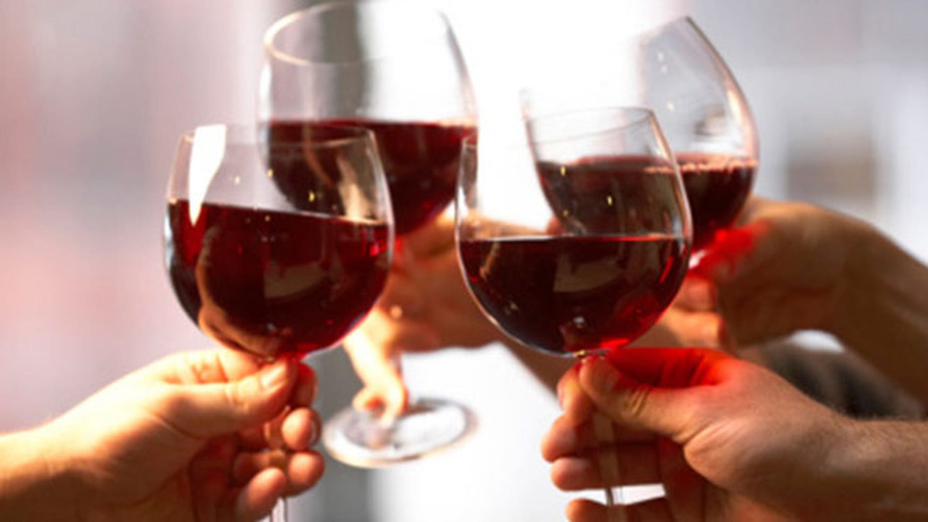 Holding a glass the right way prevents your body heat from warming the wine.