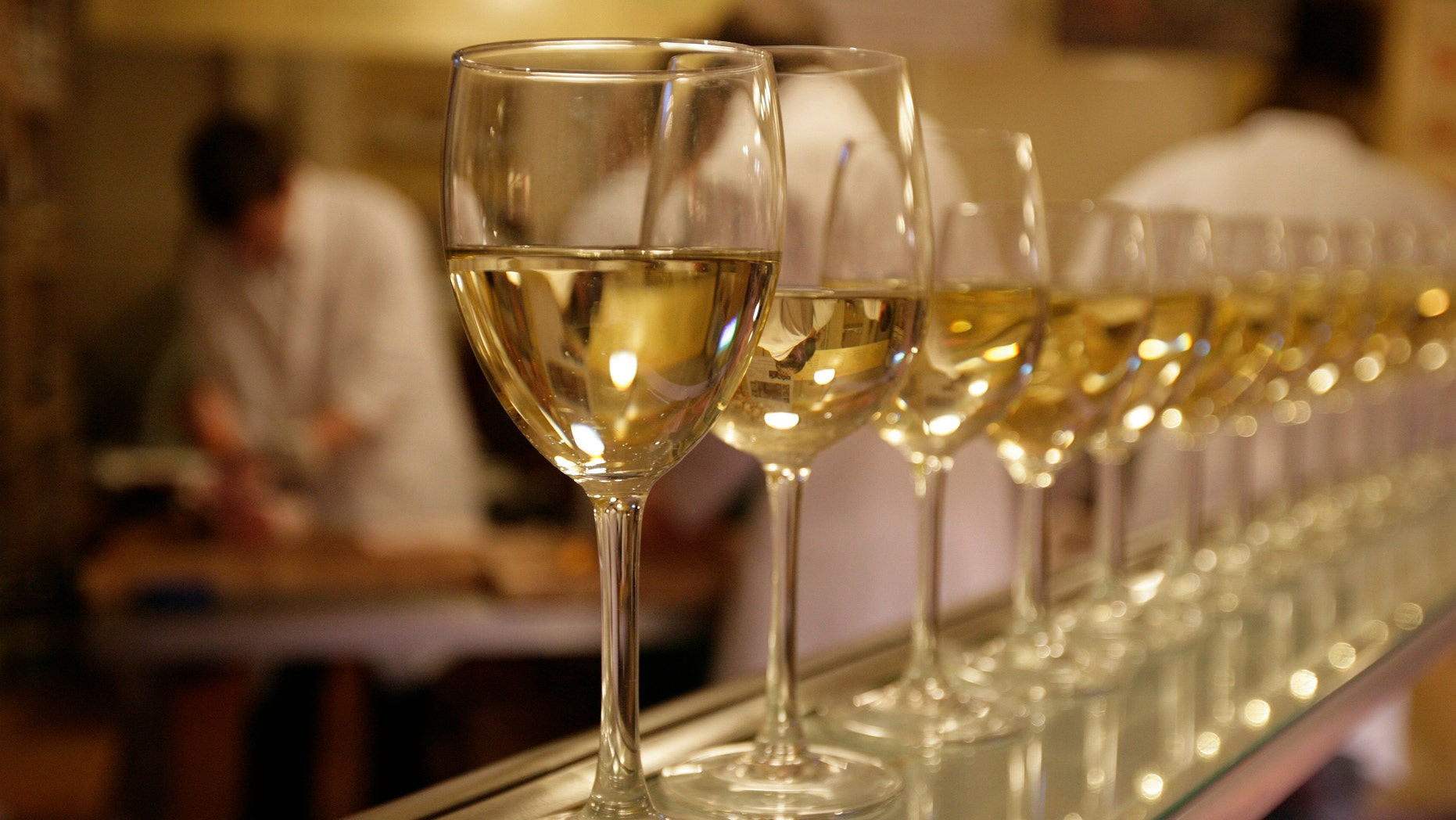 File photo - Glasses of white wine are lined up for students to drink at the end of their evening butchery class at the Ginger Pig butchery shop in central London August 25, 2009. (REUTERS/Simon Newman)