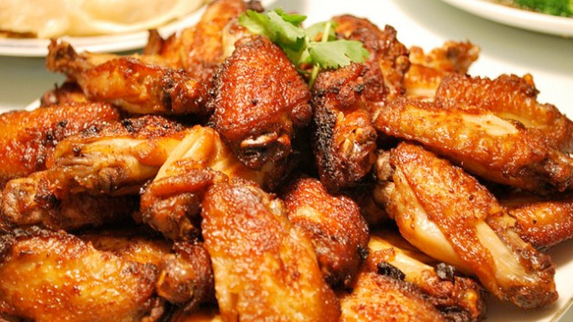 Deputies say the men placed numerous chicken wing orders with the restaurant's wholesaler and then would resell them at a reduced price.