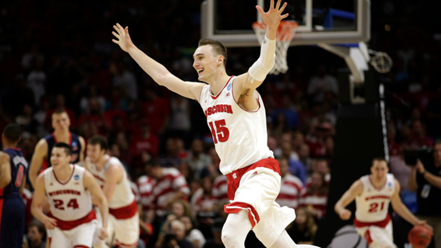 Mar. 28, 2015: Wisconsin forward Sam Dekker (15) celebrates after Wisconsin beat Arizona 85-78 in a college basketball regional final in the NCAA Tournament in Los Angeles. (AP)