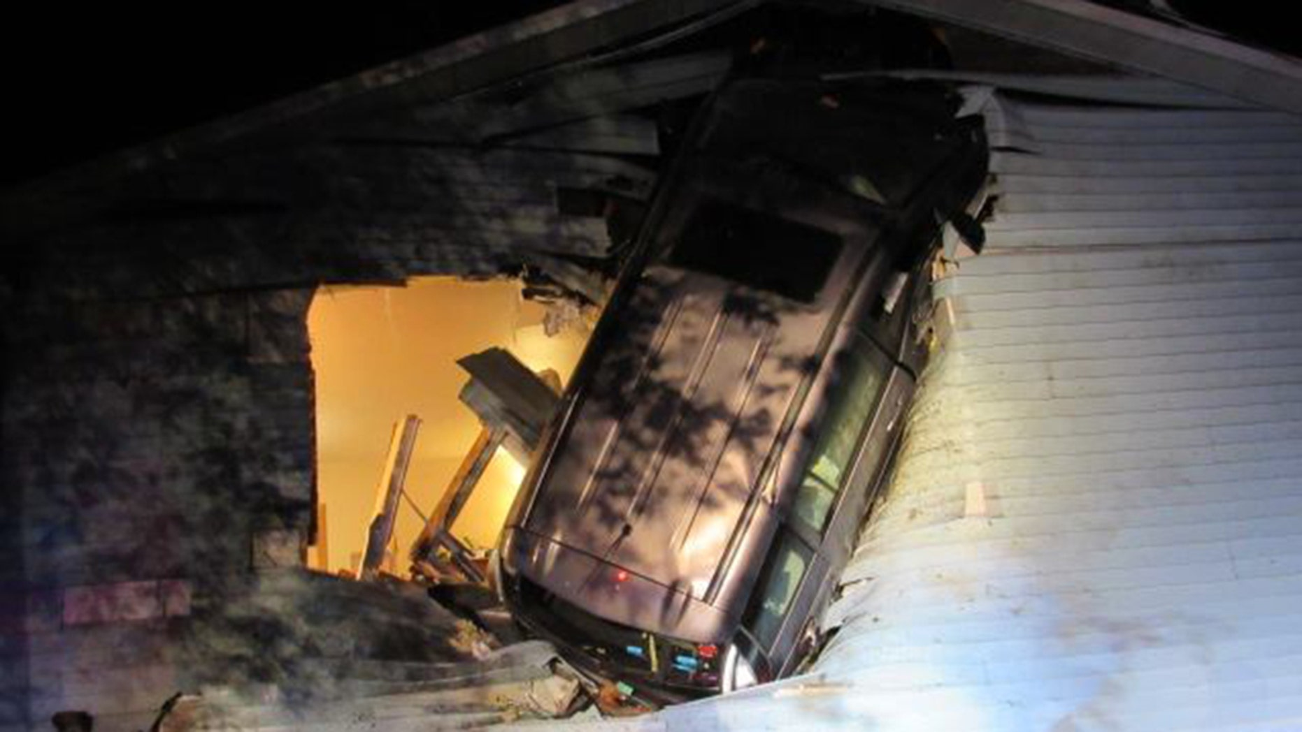 Firefighters in Wisconsin found a minivan embedded in the side of home after responding to a report of an accident.