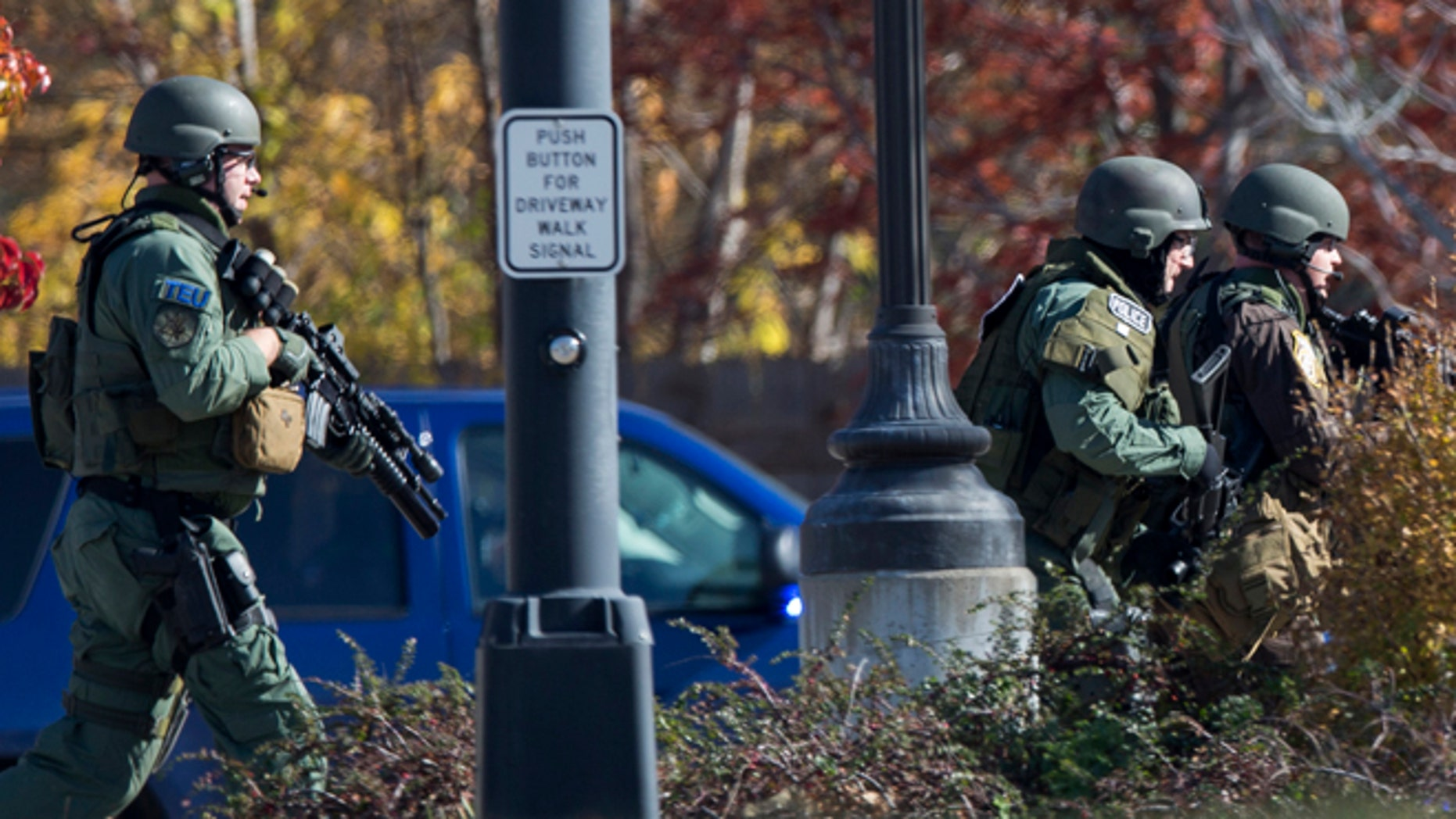 Oct. 21, 2012: Police and swat team members respond to a call of a shooting at the Azana Spa in Brookfield, Wis.  Multiple people were wounded when someone opened fire at the spa near the Brookfield Square Mall.