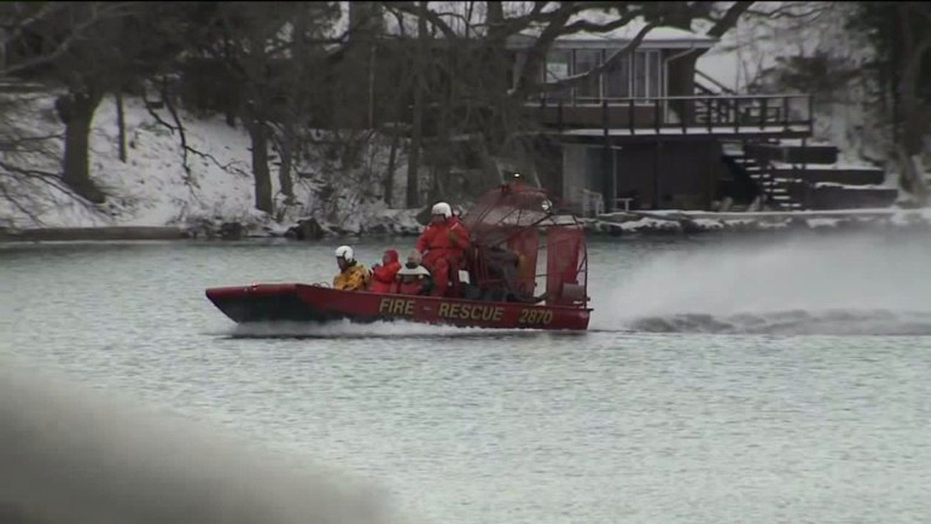 Jan. 3, 2016: A search crew looks for two missing men on Lake Beulah, in East Troy, Wis. The bodies of two other men were pulled from the lake Sunday. (WITI)