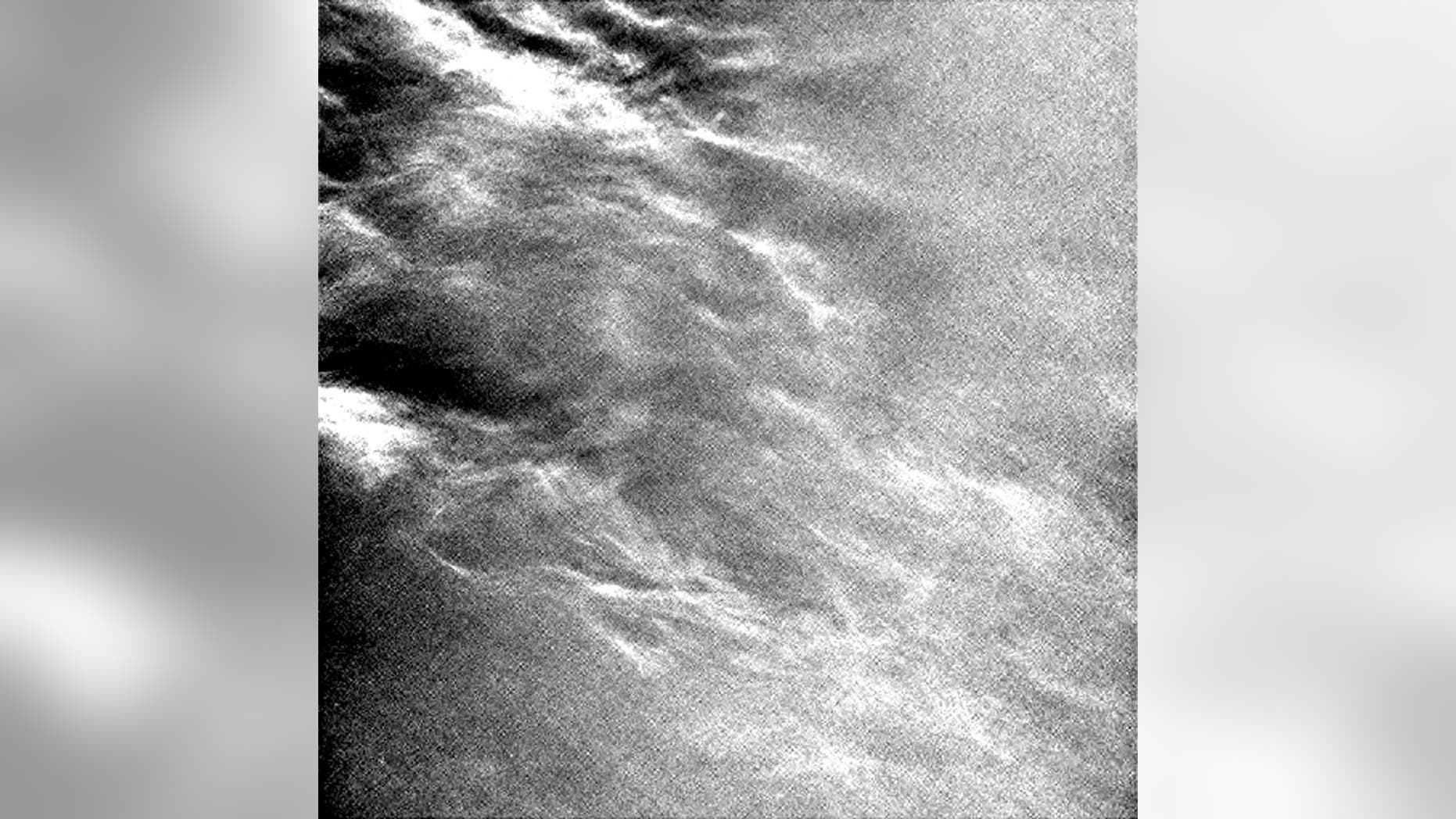 Wispy clouds streaking across Mars' sky, as imaged by the Curiosity rover.