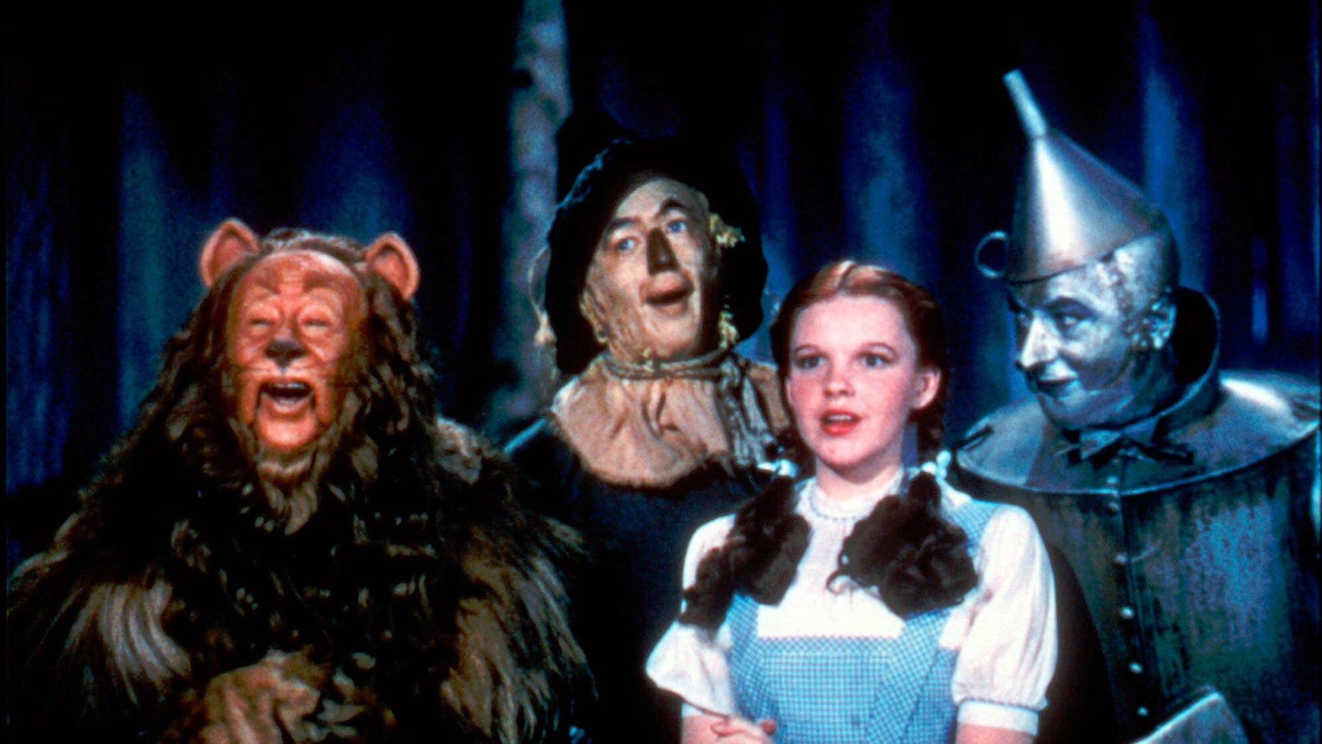 "1939. Bert Lahr as the Cowardly Lion, Ray Bolger as the Scarecrow, Judy Garland as Dorothy, and Jack Haley as the Tin Woodman, are shown in a scene from ""The Wizard of Oz.."""