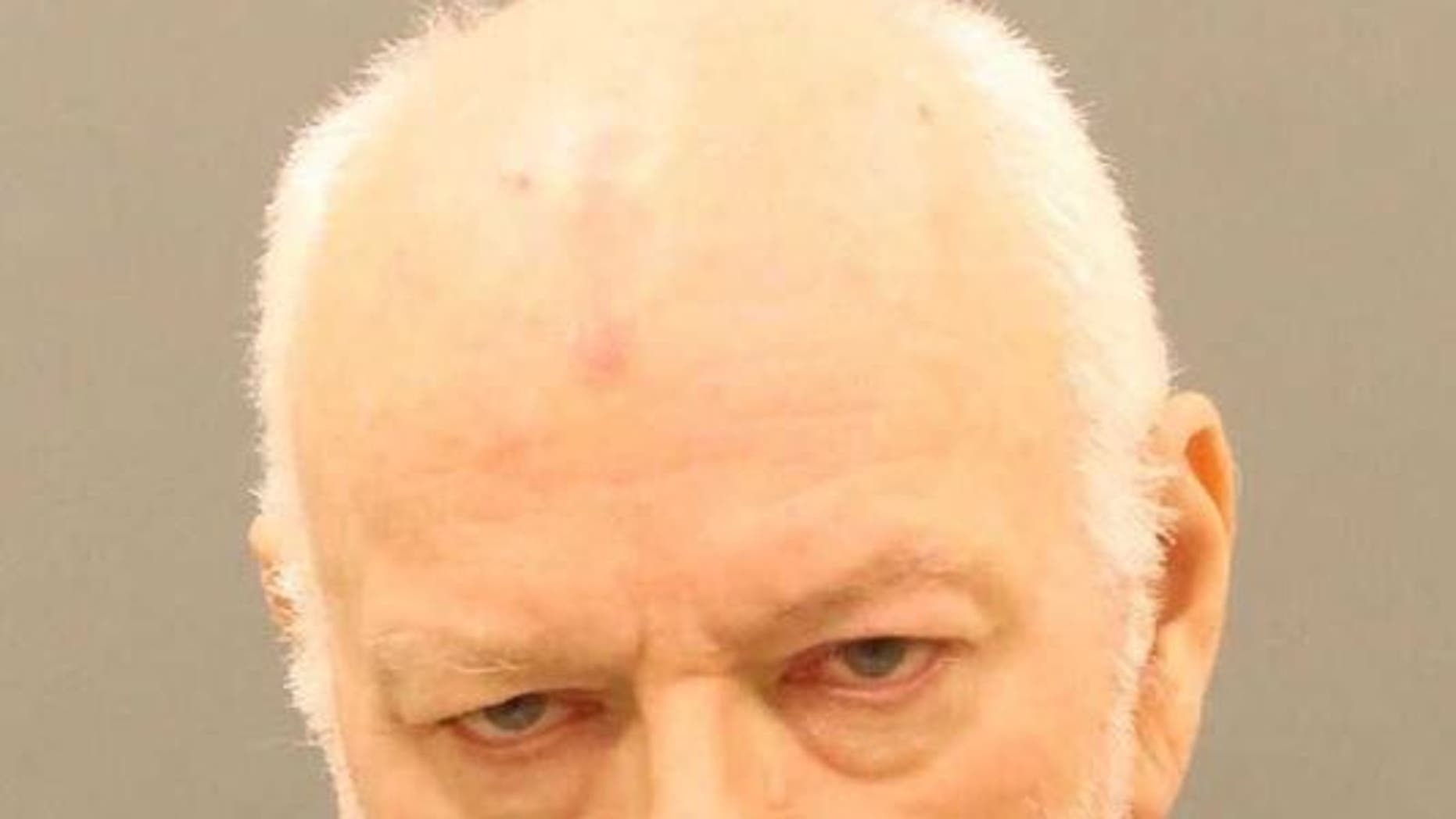 William Wolford, 66, was charged with simple assault in connection with using a leash on his wife, authorities said.