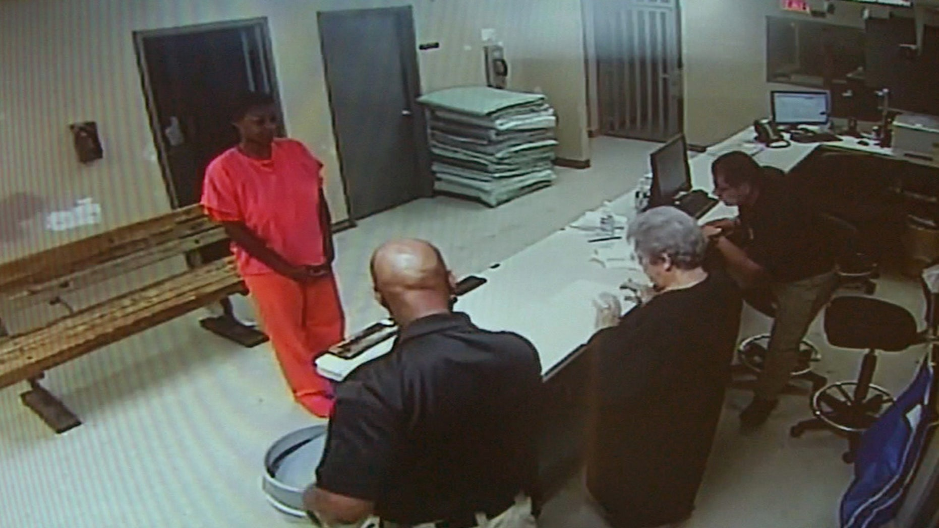 FILE - In this undated file image made from video provided by the Waller County Sheriff's Department, Sandra Bland stands before a desk at Waller County Jail in Hempstead, Texas. The small-town Texas jail where Sandra Bland died last summer needs to be replaced, and its jailers need body cameras and anger-management training, according to a report issued Tuesday, April 12, 2016 by a panel convened after Bland's death. (Waller County Sheriff's Department via AP, File)