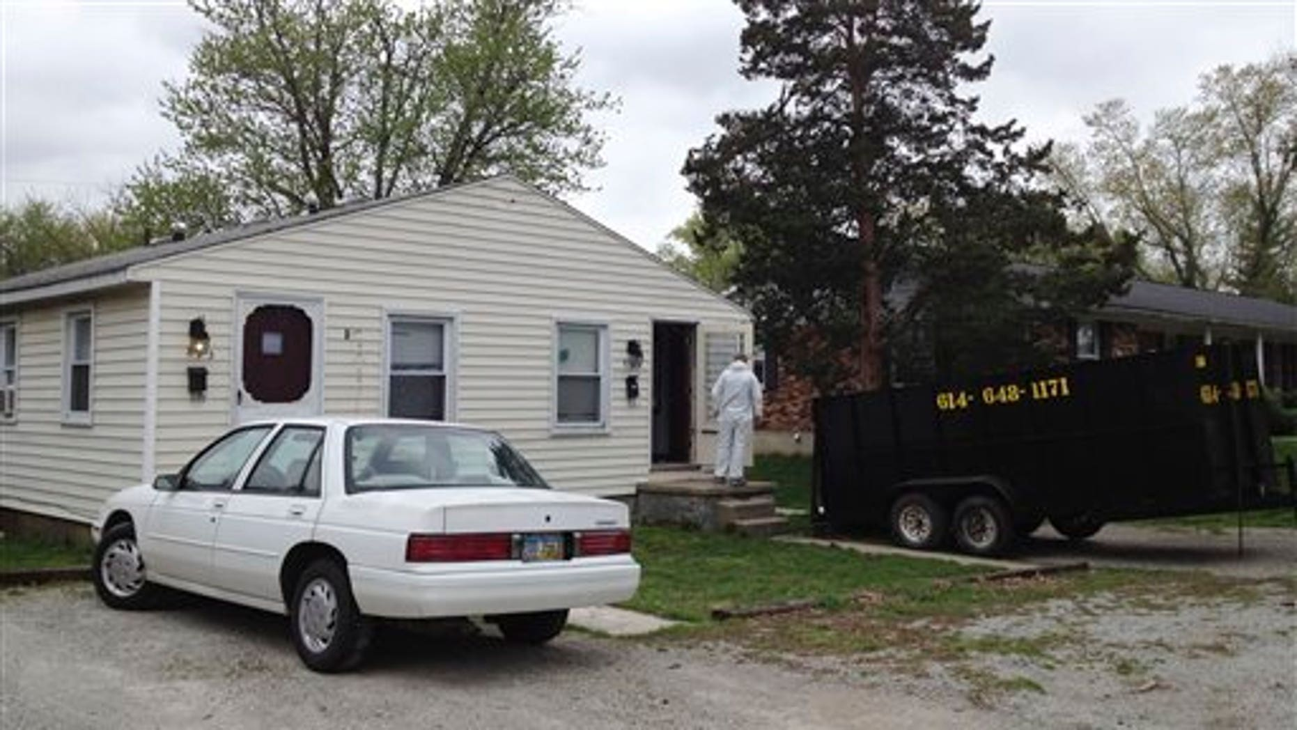 April 3: Workers clean out a home where 21-year-old Jessica Rae Sacco was killed Friday in Urbana, Ohio. A $100,000 bond has been set for 25-year-old Matthew Puccio, who is accused of stabbing and suffocating Sacco, then dismembering her body in their bathtub. Some of Sacco's remains were found in the apartment on Friday, March 30. Other body parts were found miles away in Kentucky.