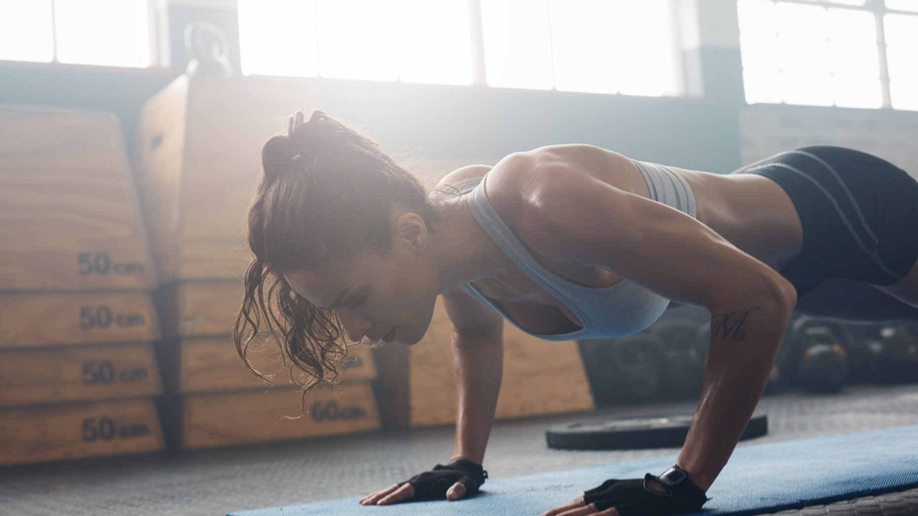 A standard push-up is one of a handful of no-equipment, military-inspired moves you can do right from your living room.