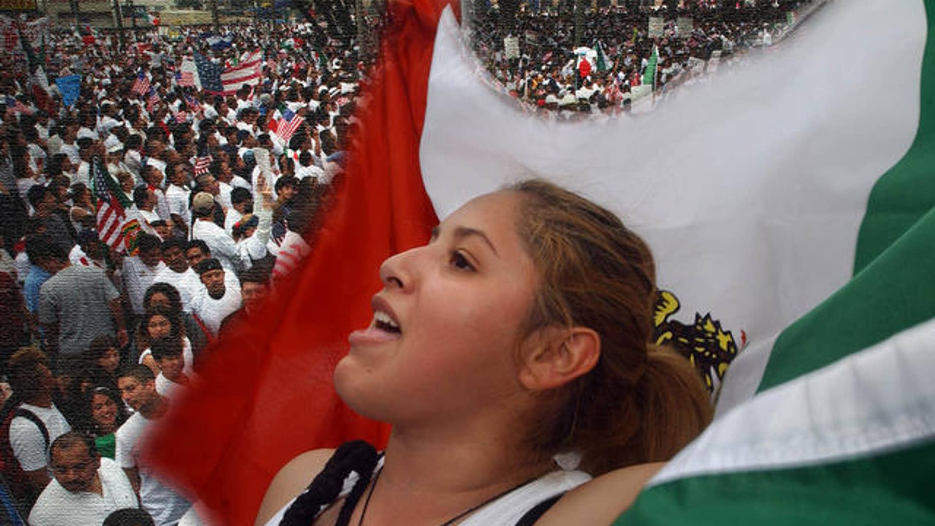 Anabel Chavarria, 17, waves a Mexican flag as she joins demonstrators gathered to protest federal immigration legislation in front of City Hall in Los Angeles, Saturday March 25, 2006. The U.S. House of Represenatives passed a bill that would make it a felony to be in the U.S. illegally, impose new penalties on employers who hire illegal immigrants and erect fences along one-third of the U.S.-Mexican border. The Senate is to begin debating the proposals on Tuesday. (AP Photo/Ann Johansson)