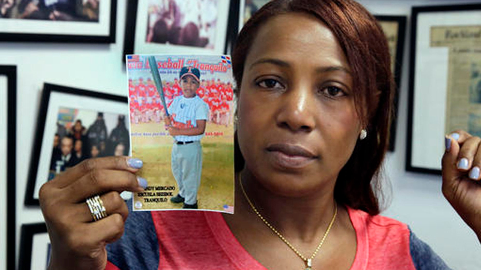 Maribel Martinez holds a photo of her son Andy at her attorney's office, in the Brooklyn borough of New York, Thursday, Sept. 1, 2016. Martinez says she hasn't stopped crying since JetBlue airlines mistook her 5-year-old for another child and flew him to the wrong city. (AP Photo/Richard Drew)