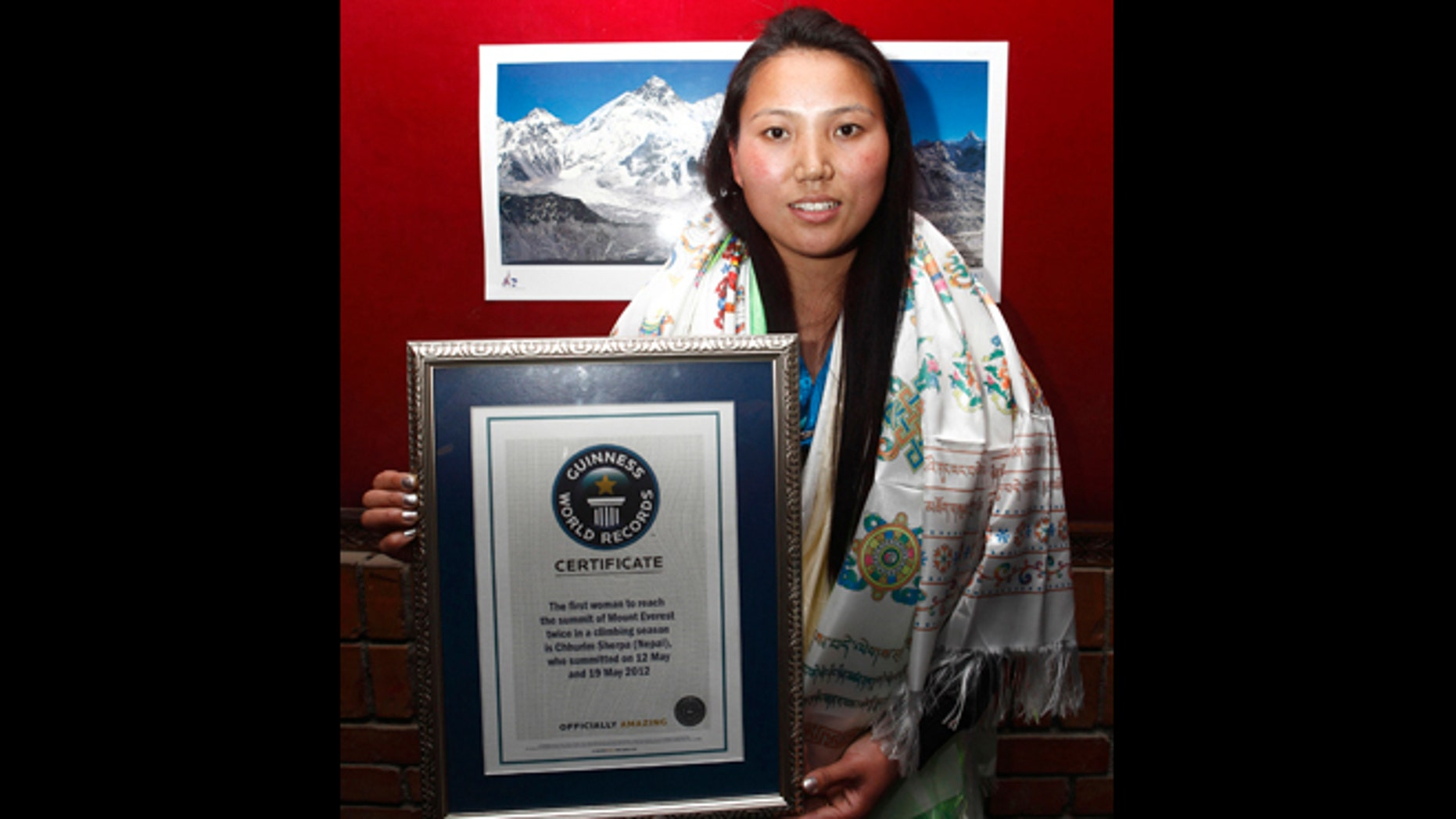 Feb. 25, 2013: Nepalese woman mountaineer Chhurim who has been recognized by Guinness World Records for climbing Mount Everest twice in the same climbing season poses with the certificate issued to her in Katmandu, Nepal.