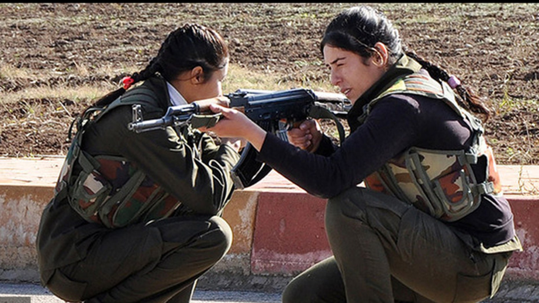 Female fighters like these Kurdish women are being joined by Syriac Christian women in the fight against ISIS. (Reuters)