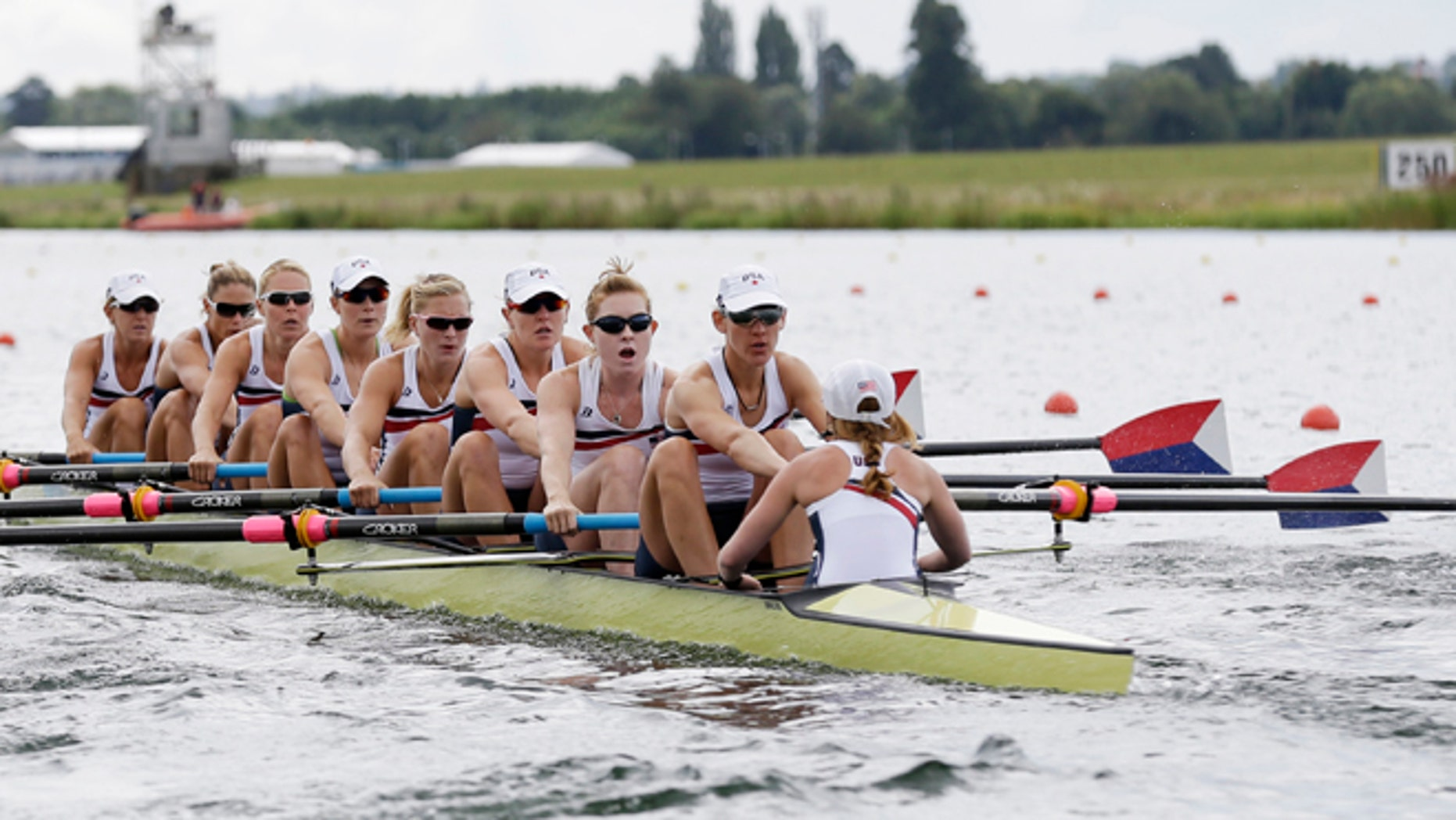 July 29, 2012: U.S. rowers, from right, Mary Whipple, Caryn Davies, Caroline Lind, Eleanor Logan, Meghan Musnicki, Taylor Ritzel, Esther Lofgren, Zsuzsanna Francia, and Erin Cafaro stroke during a women's rowing eight heat in Eton Dorney, near Windsor, England, at the 2012 Summer Olympics.