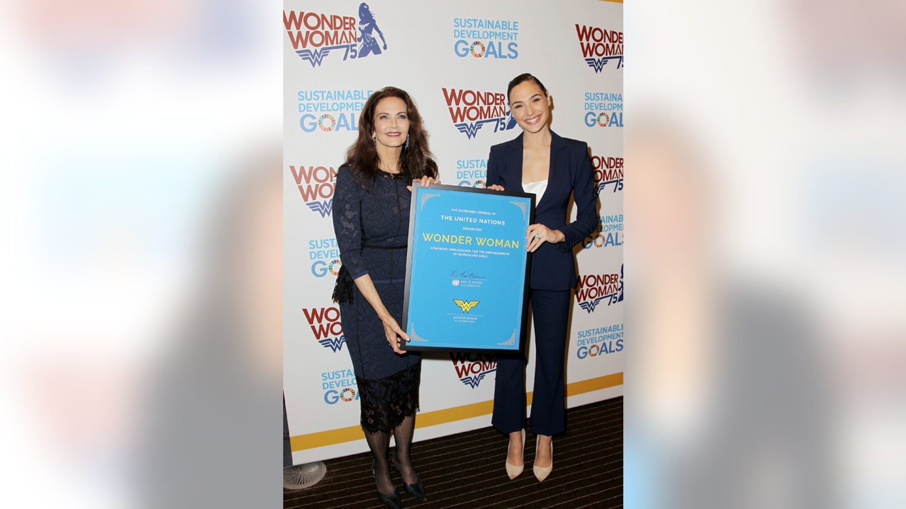 """Oct. 21, 2016: Actress Lynda Carter, who starred in the 1970s series,""""Wonder Woman,"""" left, and actress Gal Gadot, who stars in the upcoming film, """"Wonder Woman,"""" appear at a United Nations event naming the superhero character as an Honorary Ambassador For the Empowerment of Women and Girls"""