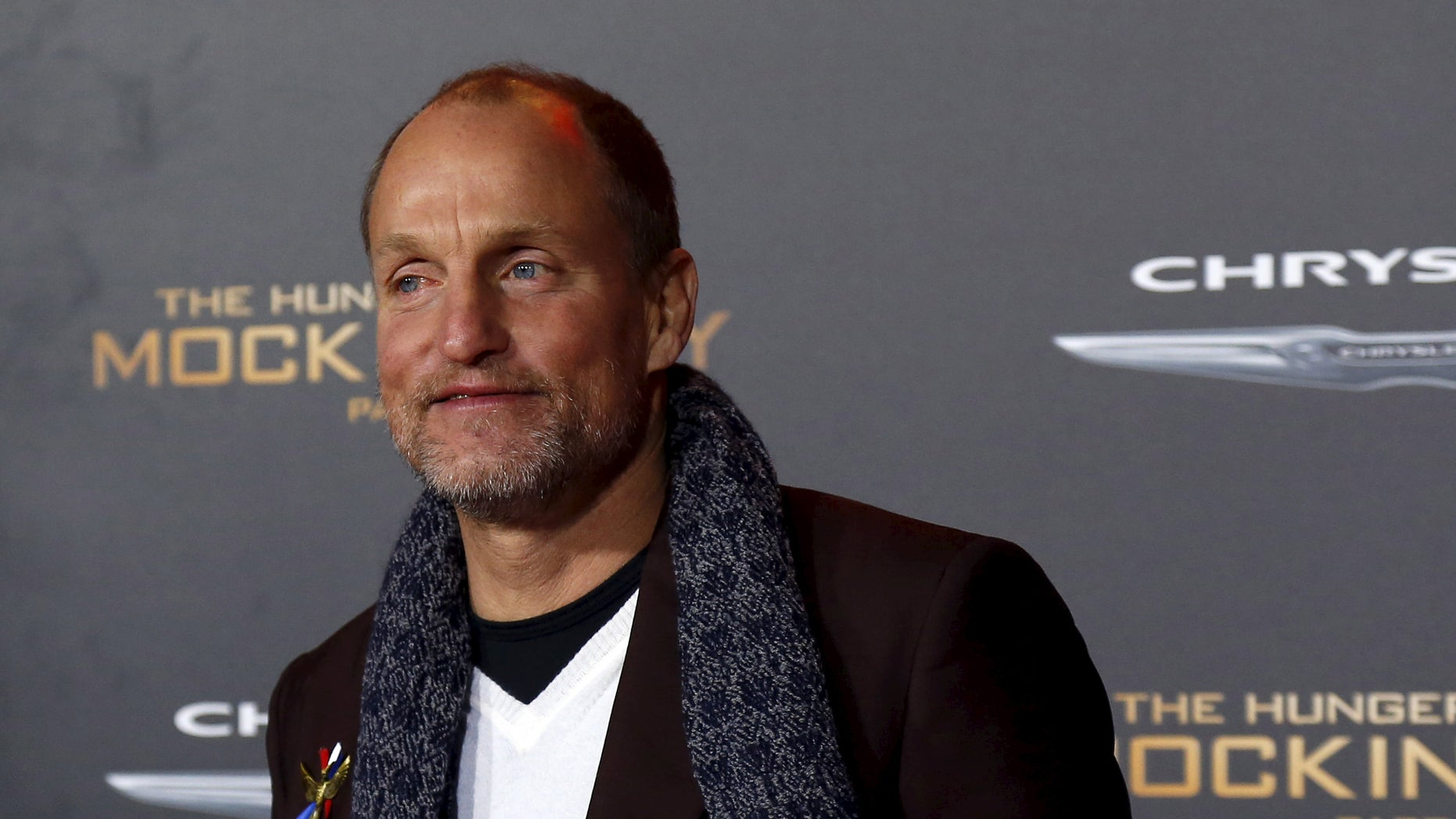 """Cast member Woody Harrelson poses at the premiere of """"The Hunger Games: Mockingjay - Part 2"""" in Los Angeles, California November 16, 2015. The movie opens in the U.S. on November 20.  REUTERS/Mario Anzuoni - RTS7H8K"""