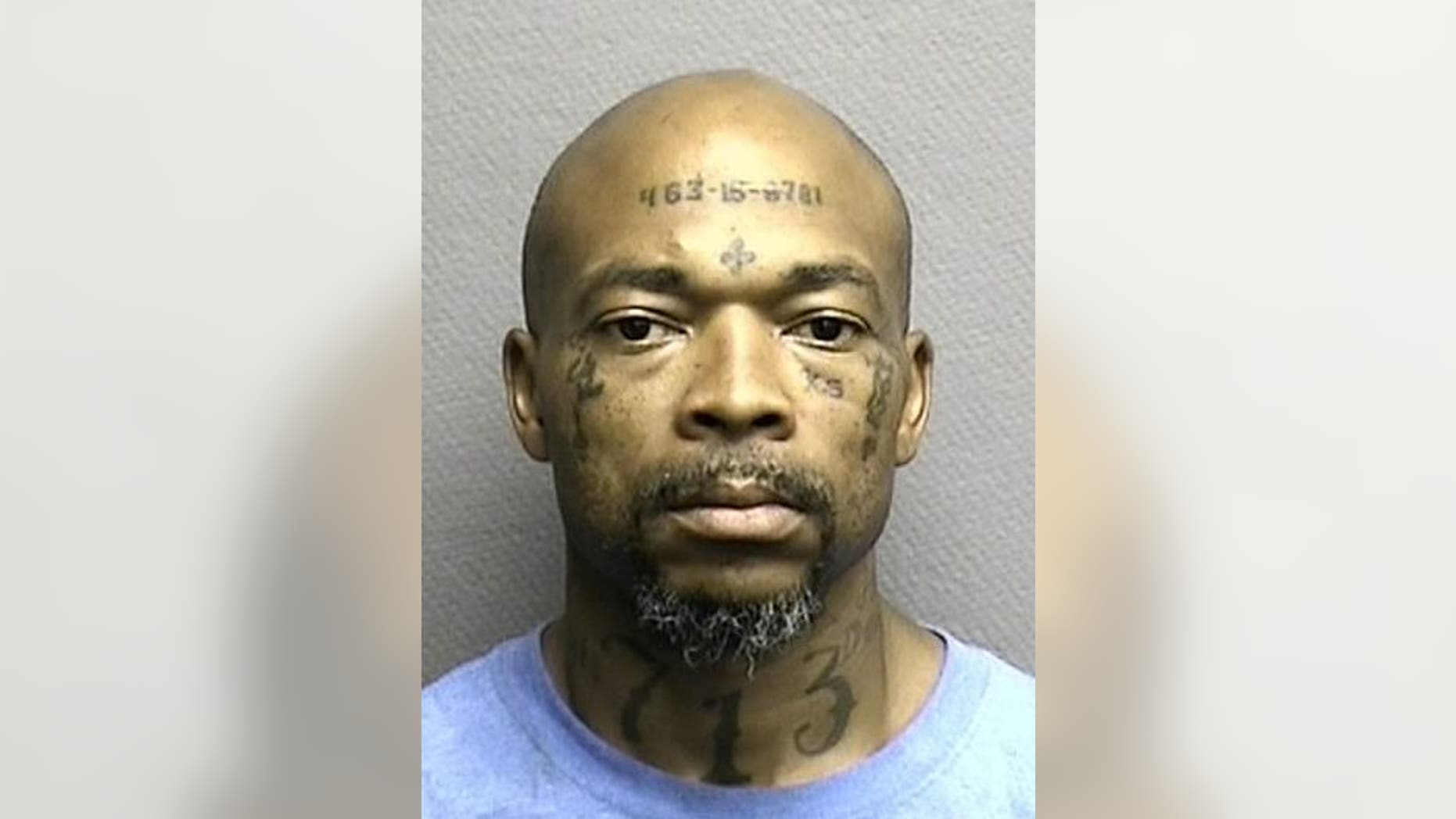 """Robert Wooten has his social security number and the area code """"713"""" tattooed on his face and neck."""