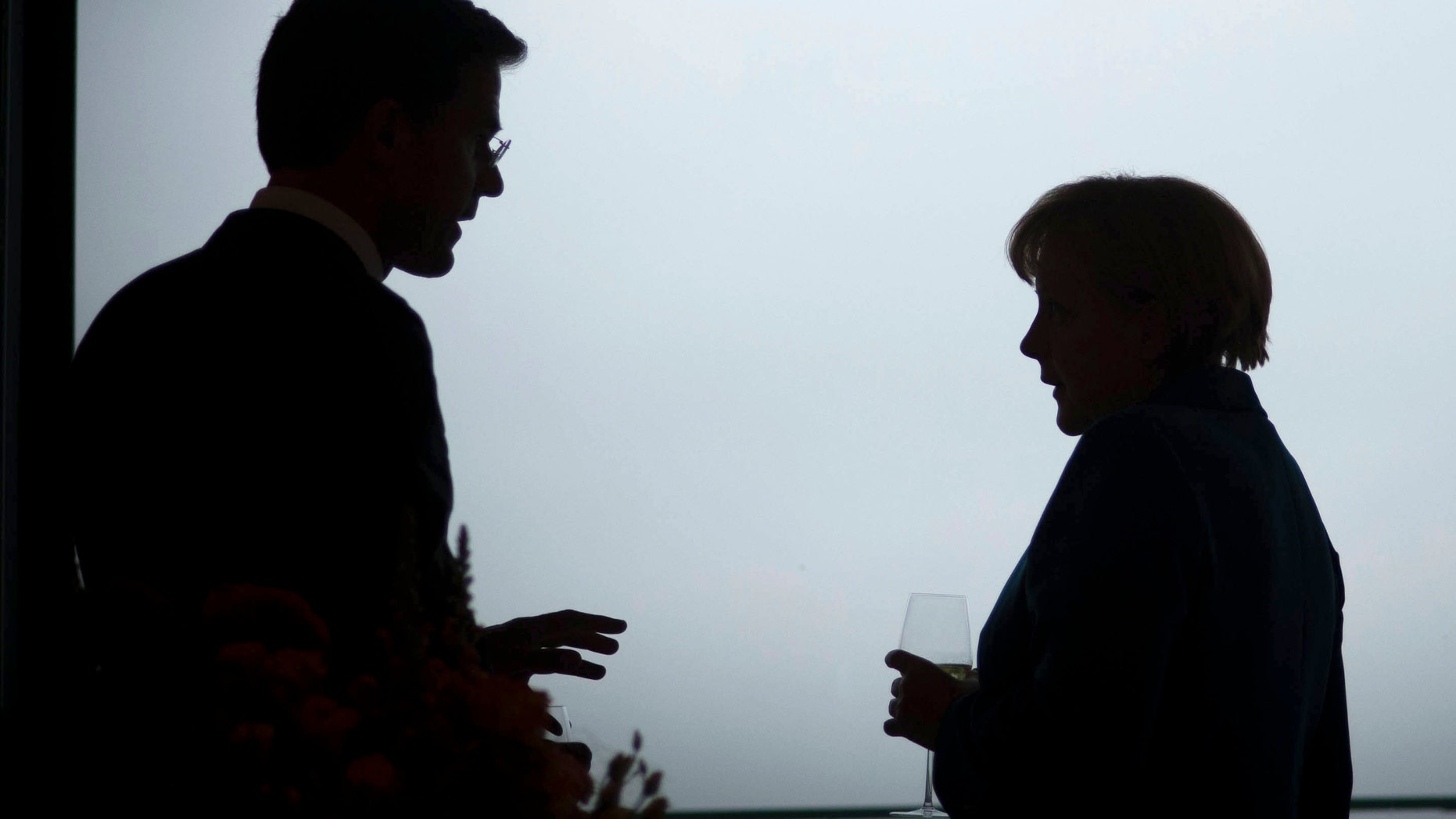 """BERLIN, GERMANY - JUNE 20:  In this photo provided by the German Government Press Office (BPA), German Chancellor Angela Merkel talks with the Dutch Prime Minister Mark Rutte (L) ahead of a working dinner at the Chancellery on June 20, 2012 in Berlin, Germany. Merkel told a joint press conference held with Rutte that while bailout schemes proposed to aid the Eurozone crisis include options to purchase state debt through the secondary bond market, this was not under discussion and was """"purely theoretical"""".  (Photo by Guido Bergmann - Pool/Bundesregierung-Pool via Getty Images)"""