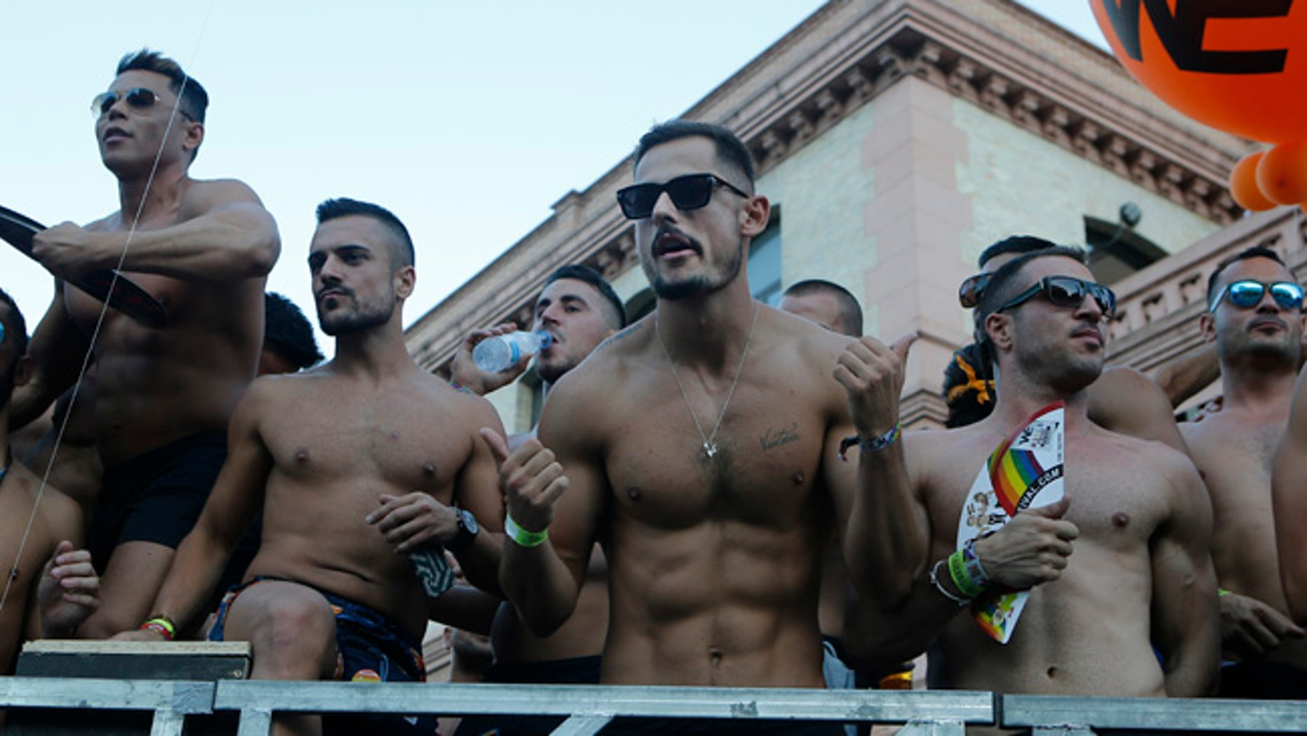 Participants dance on a open truck during the Gay Pride demonstration and parade, the climax of the 10-day WorldPride festivities, in Madrid, Spain, Saturday, July 1, 2017. Hundreds of thousands of people are marching in a global gay pride demonstration in Madrid under tight security measures on Saturday. (AP Photo/Paul White)