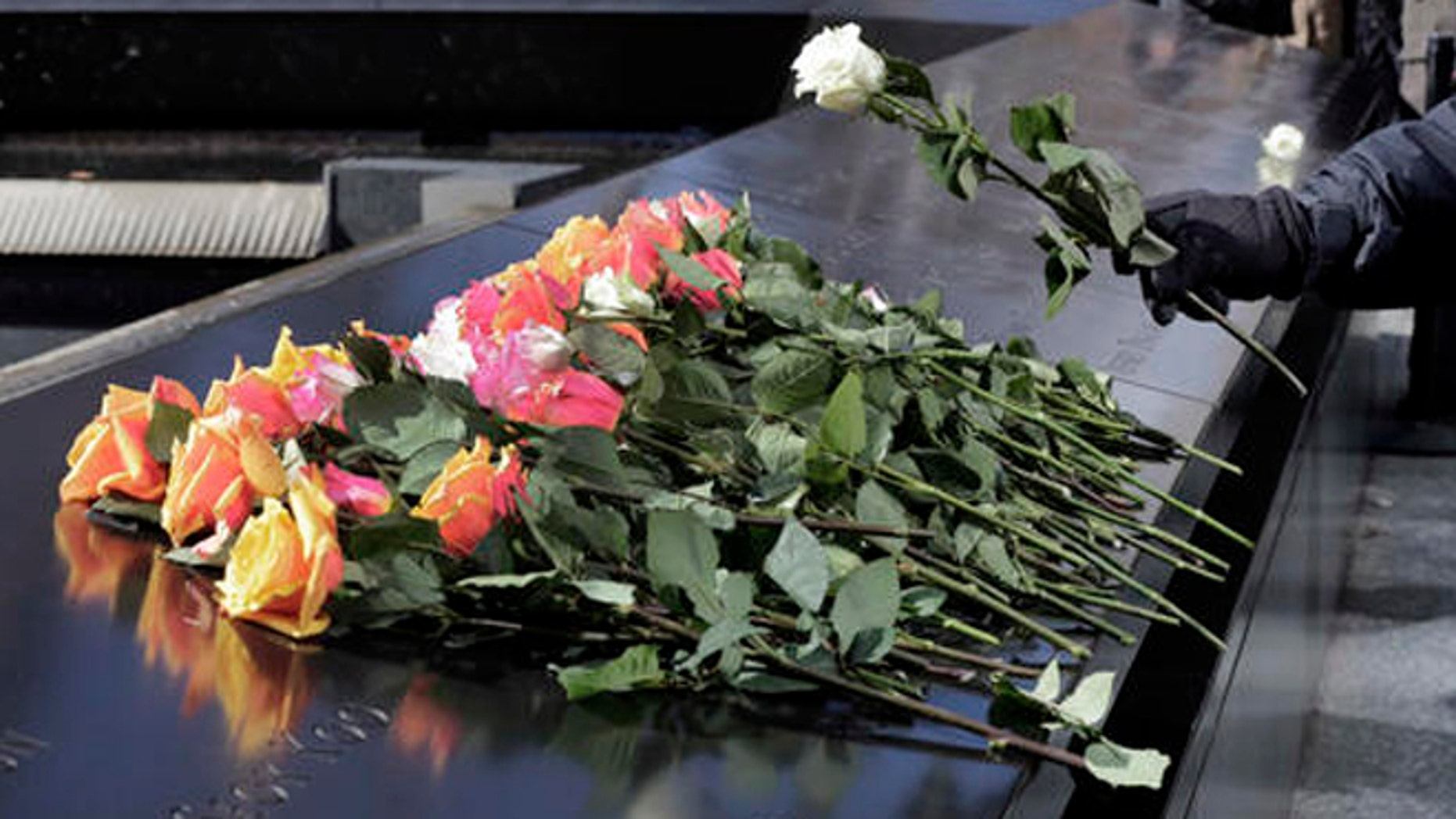 A rose is placed on the 9/11 Memorial during a ceremony commemorating the 23rd anniversary of the 1993 World Trade Center bombing that killed six people and injured more than 1,000, in New York, Friday, Feb. 26, 2016. (AP Photo/Richard Drew)