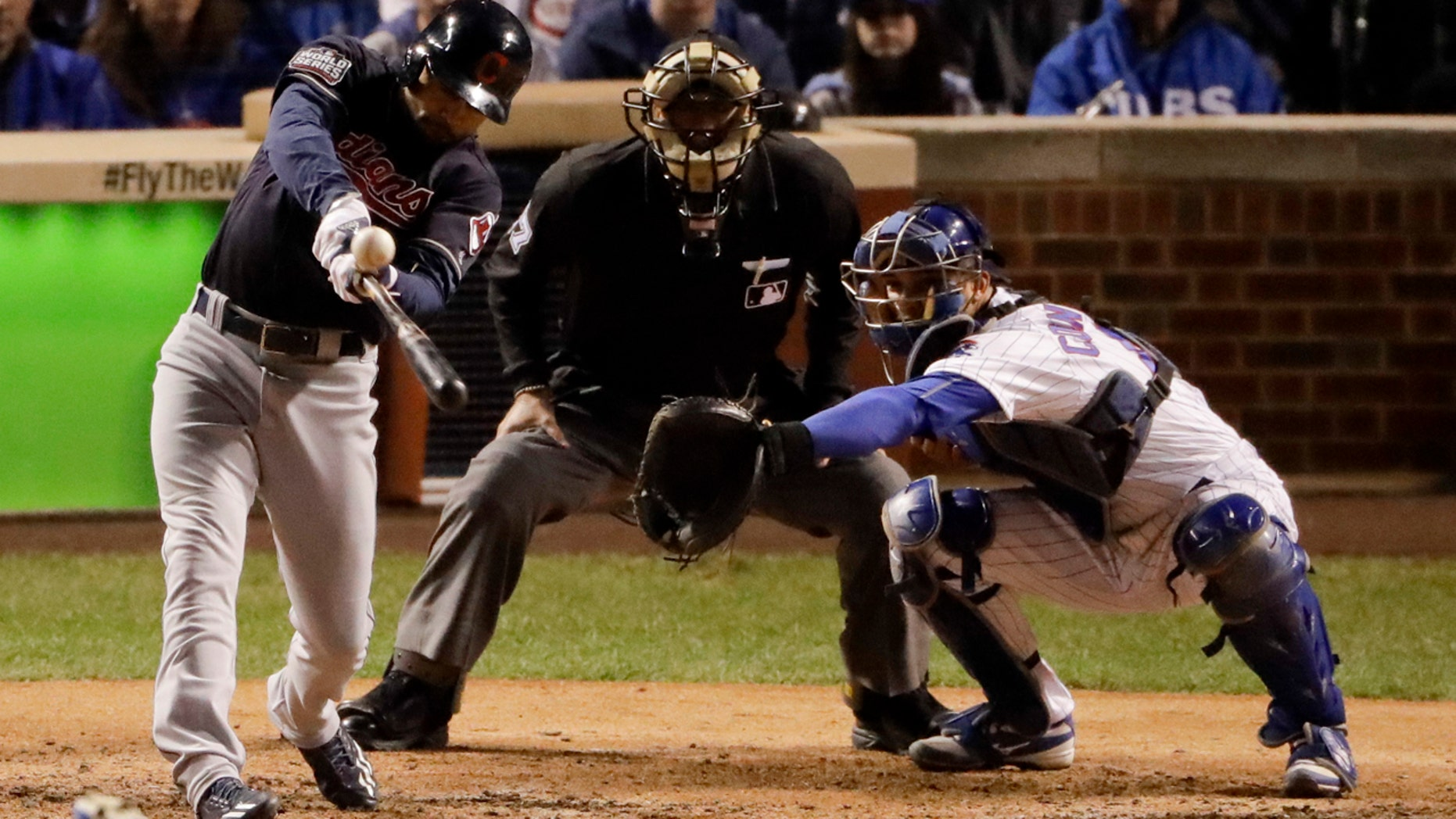Oct. 28, 2016: Coco Crisp of the Cleveland Indians hits a RBI-single against the Chicago Cubs during the seventh inning of Game 3 of the World Series in Chicago.