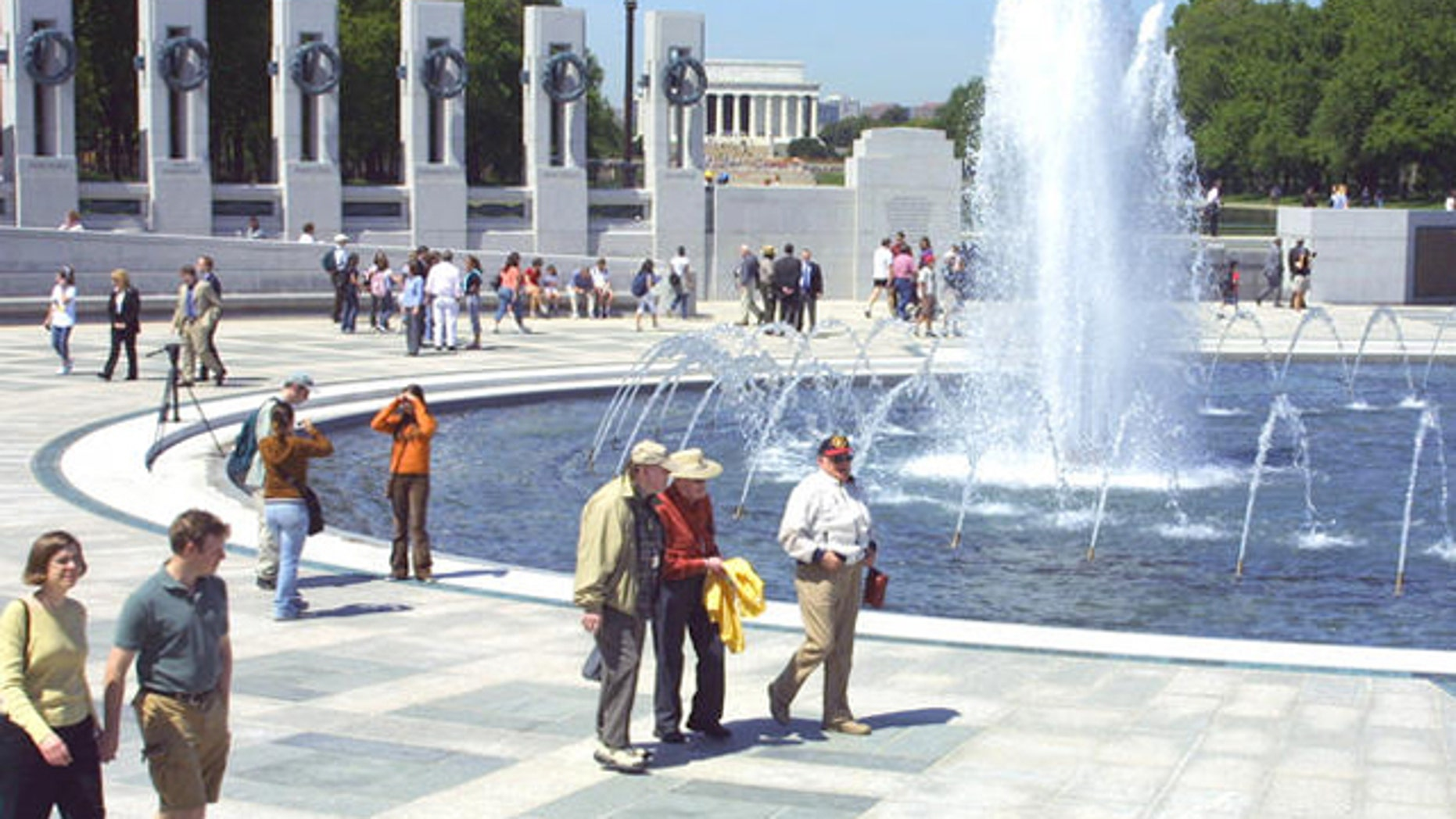 FILE: Visitors tour the US National World War II Memorial fountains and plaza.