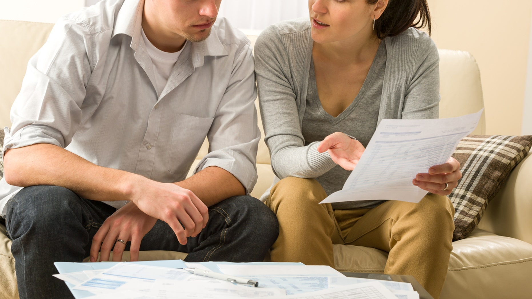 Worried couple talking about their expenses and financial problems
