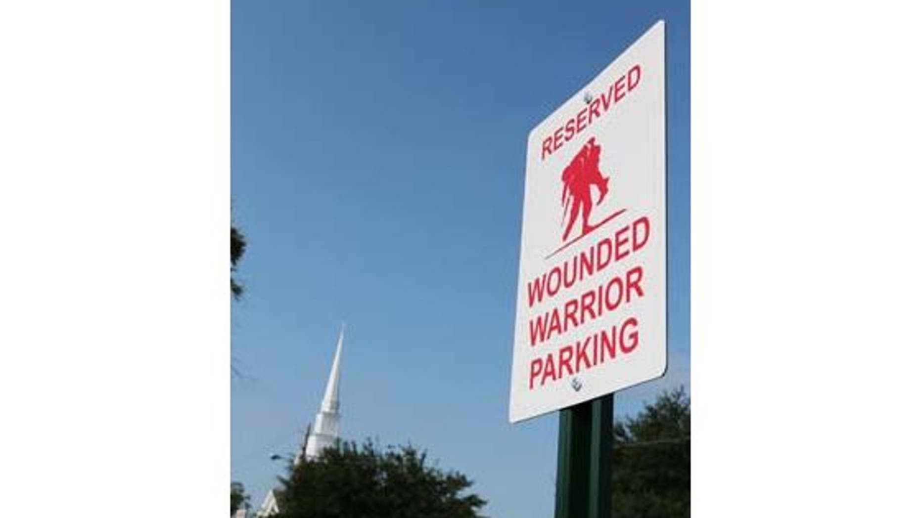 The Daily News of Jacksonville reports that the wounded red-and-white warrior parking signs will feature a logo of a soldier carrying a wounded fellow soldier from the battlefield. (John Althouse/The Daily News)