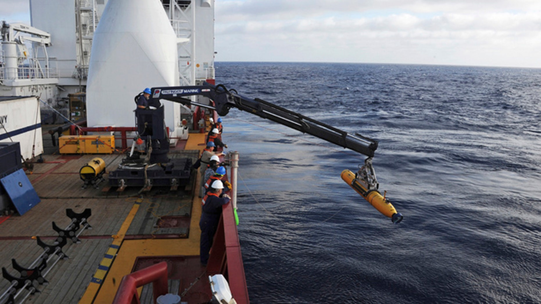 FILE 2014: Operators aboard the Australian Defense Vessel Ocean Shield move the U.S. Navy's Bluefin 21 autonomous underwater vehicle into position for deployment in the Southern Indian Ocean.
