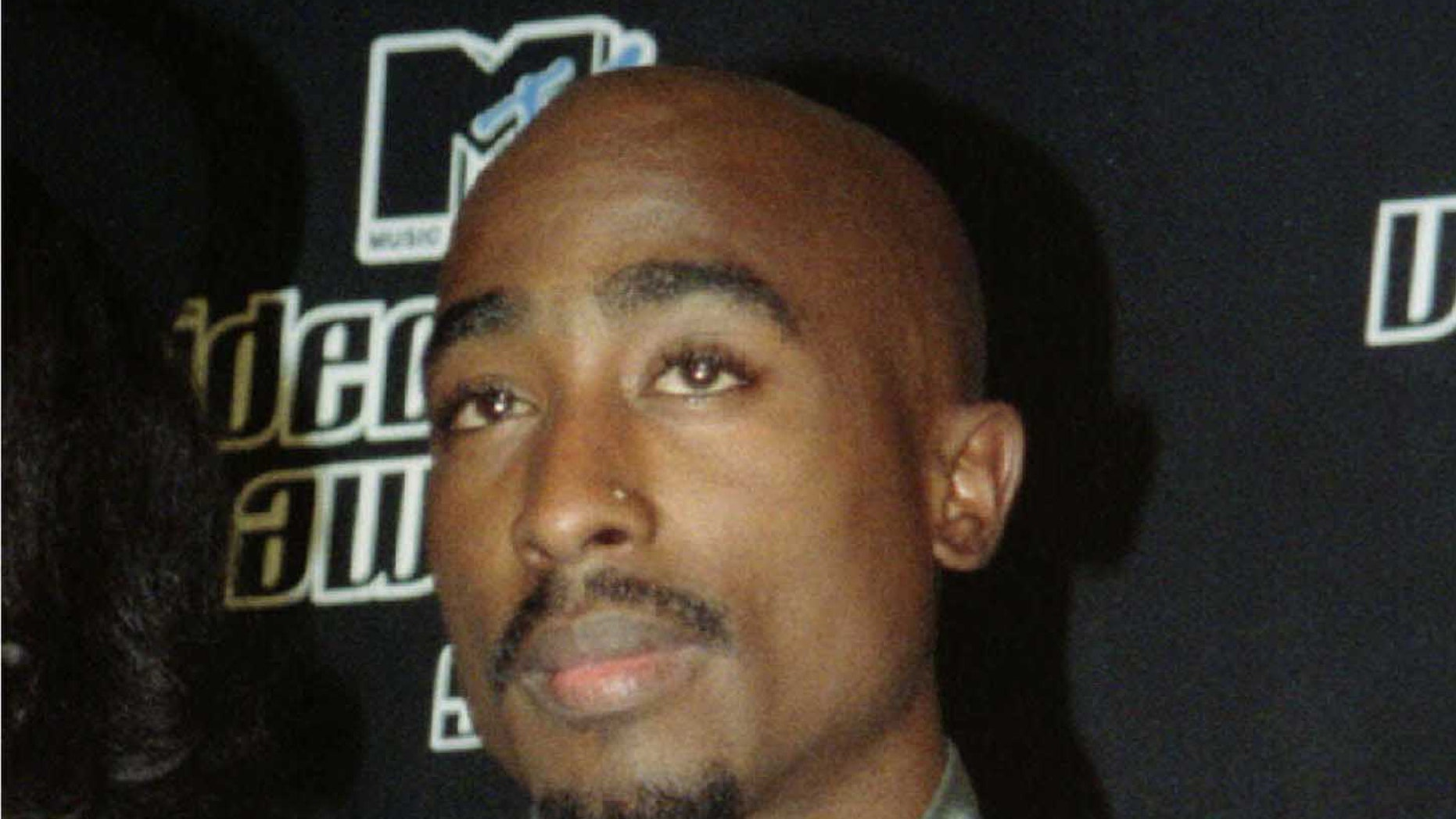 Rapper Tupac Shakur appears at the MTV Music Video Awards in New York on Sept. 4, 1996.