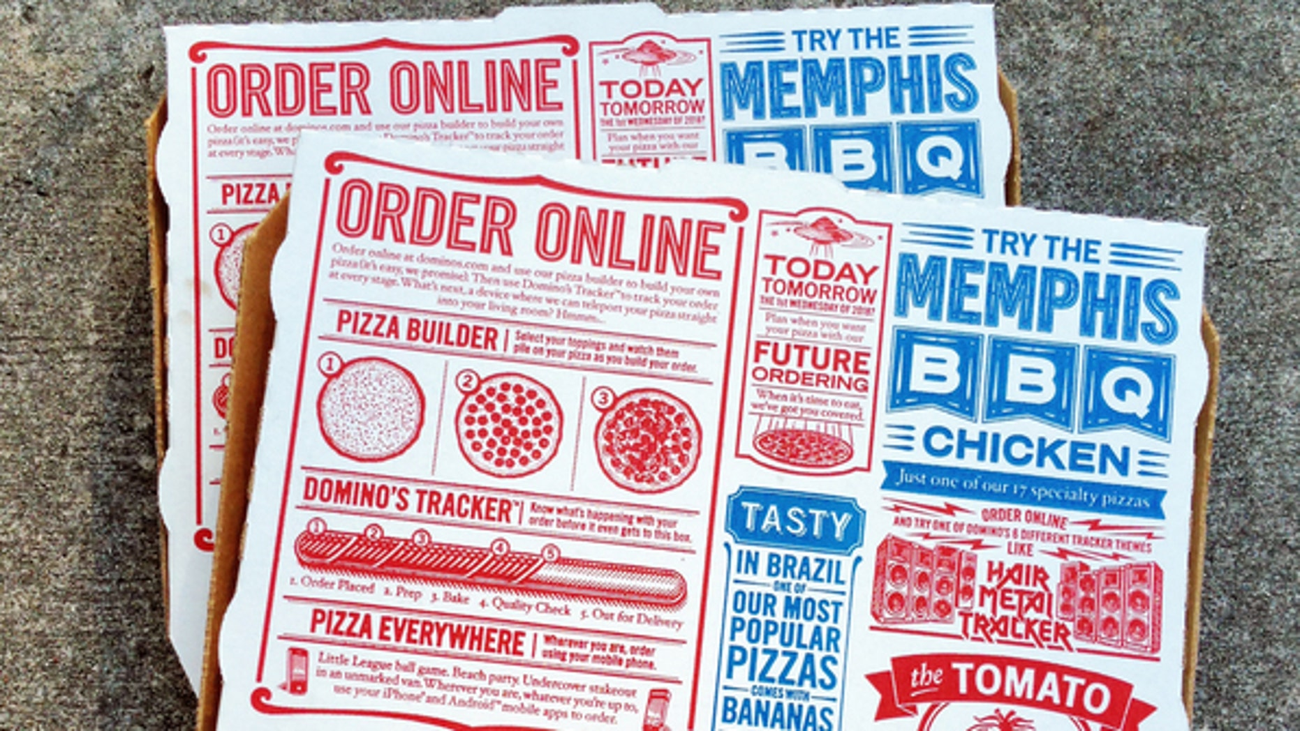 """""""West Palm Beach, USA - March 7, 2013: Two Domino's Pizza boxes. Domino's is one of the largest pizza delivery franchises in the USA. The packaging is covered with ads and pizza trivia, as well as ways to access Domino's through mobile phone apps and social media sites like Facebook and Twitter."""""""