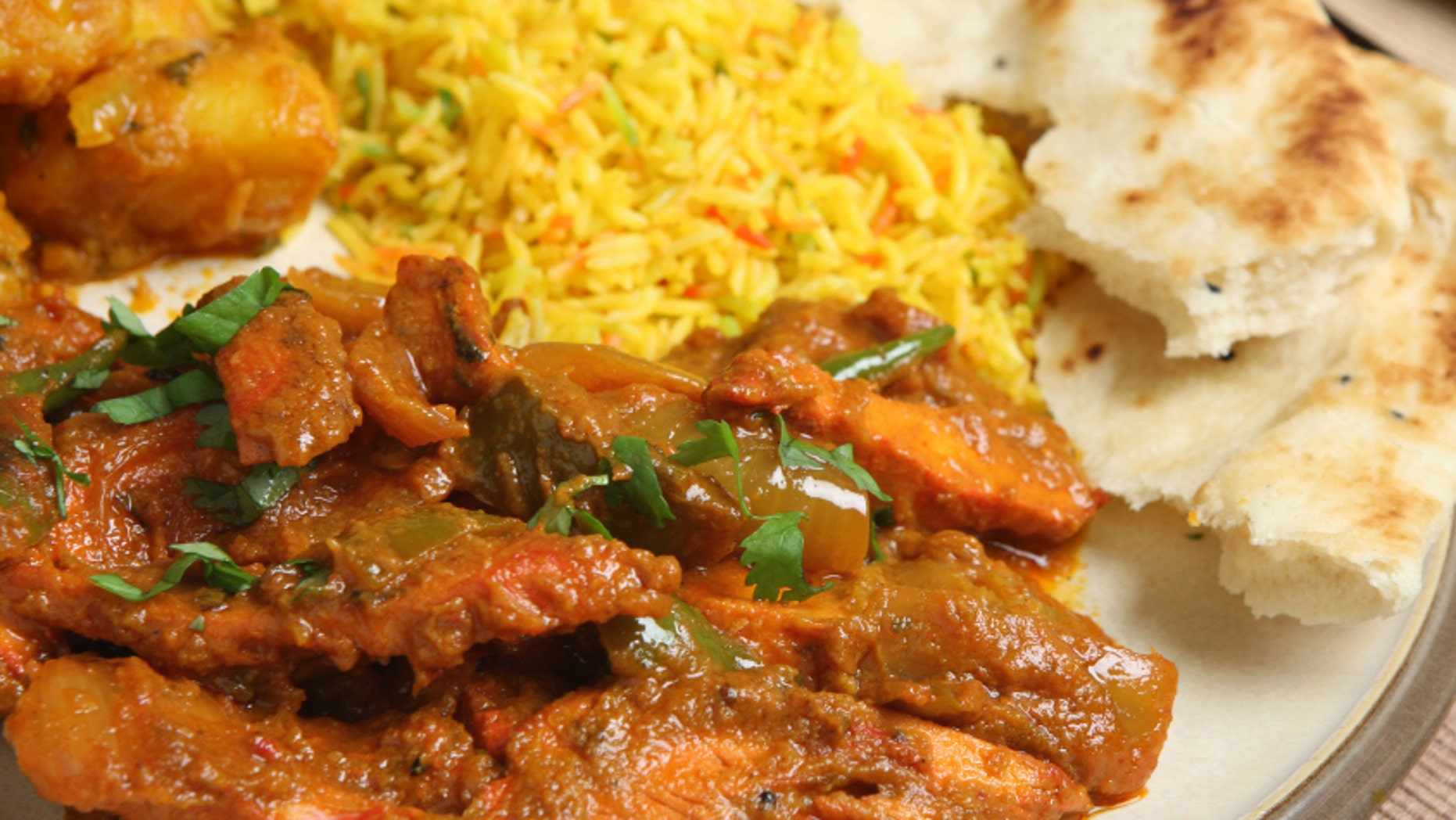 Indian chicken jalfrezi with Bombay aloo, pilau rice and naan bread.