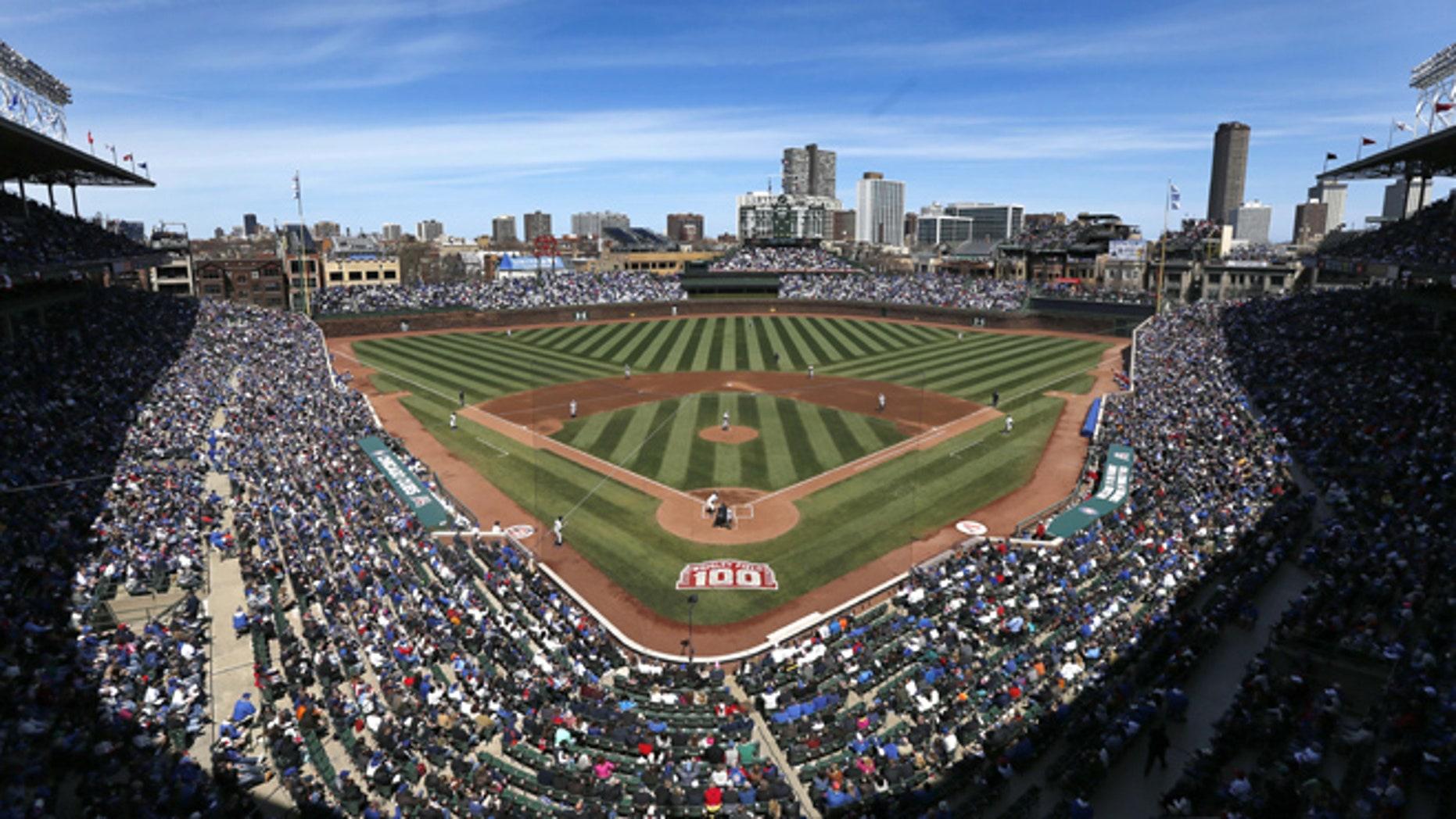 April 23, 2014: The Arizona Diamondbacks and Chicago Cubs begin a baseball game at Wrigley Field.
