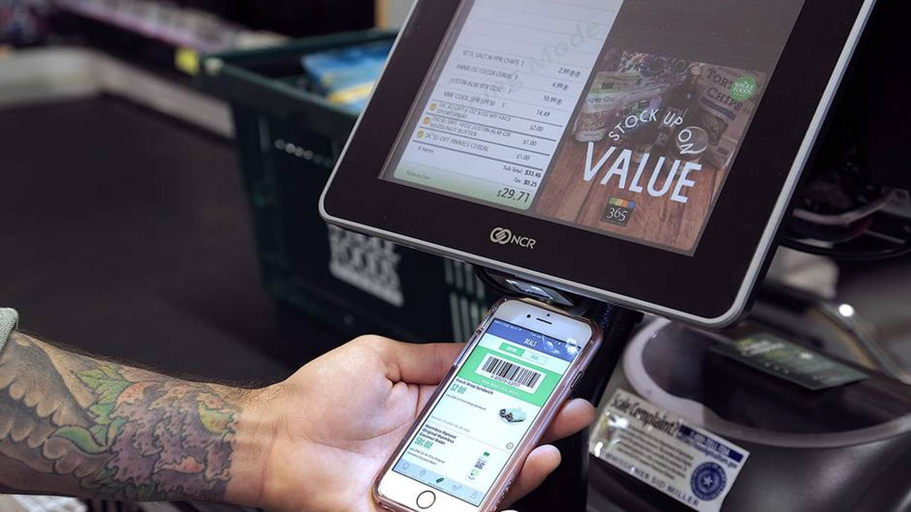 Whole Foods new rewards program works via smartphone app.