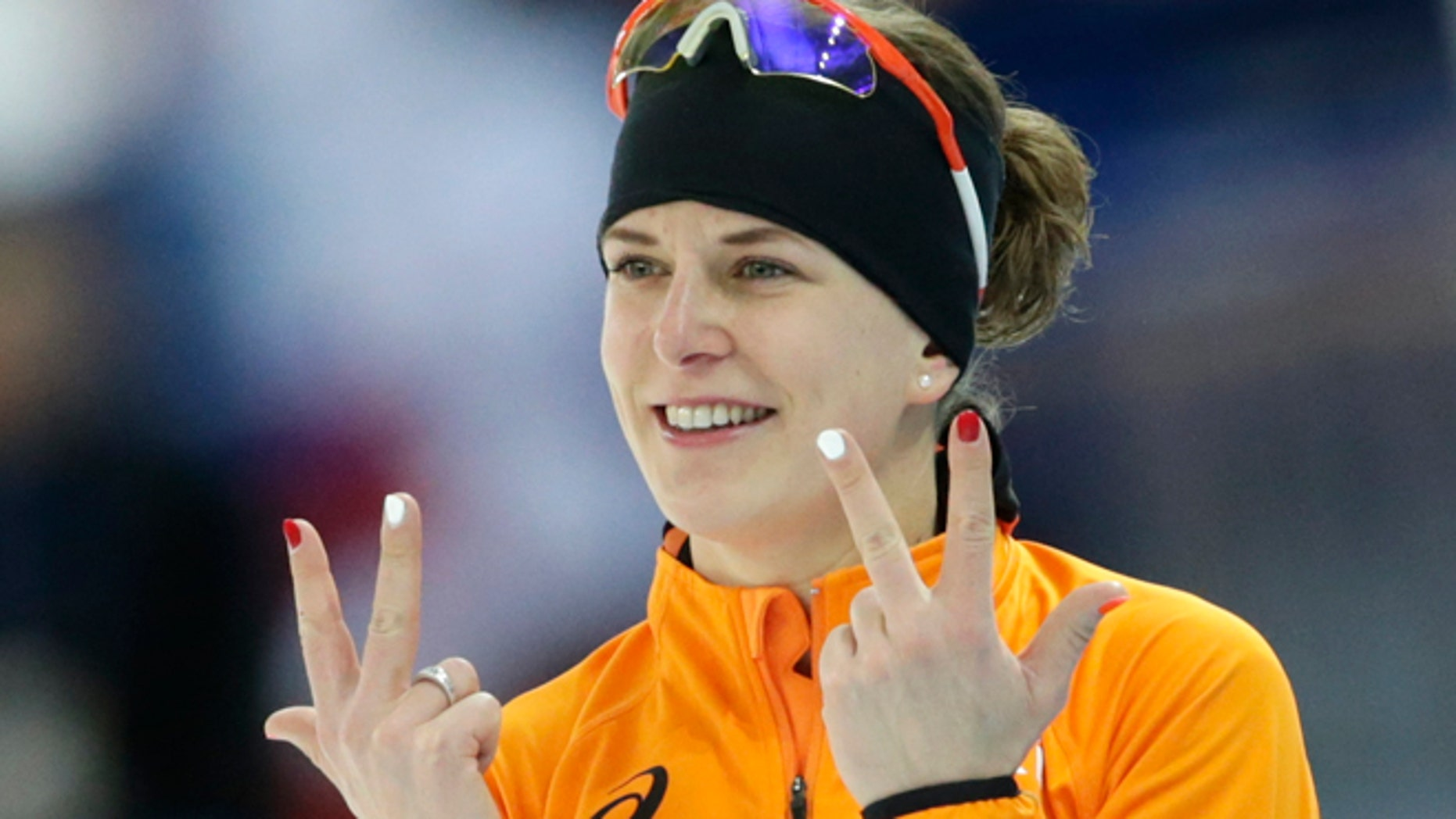 Feb. 9, 2014: Ireen Wust of the Netherlands flashes three fingers in each hand, indicating her third olympic gold medal, after winning gold in the women's 3,000-meter speedskating race at the Adler Arena Skating Center during the 2014 Winter Olympics in Sochi, Russia.