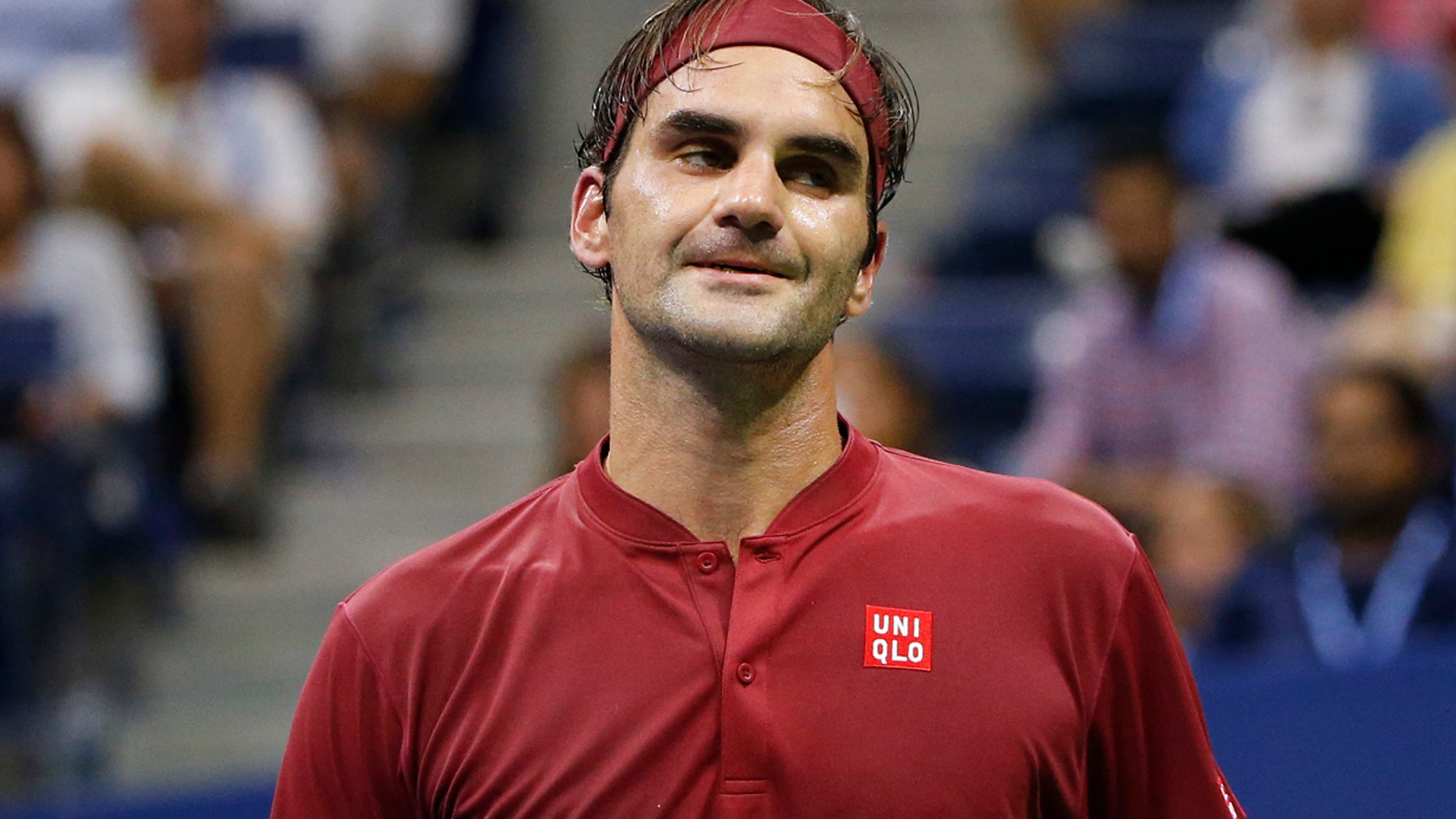 SEPT. 3: Roger Federer, of Switzerland, reacts after losing a point to John Millman, of Australia, during the fourth round of the U.S. Open tennis tournament.