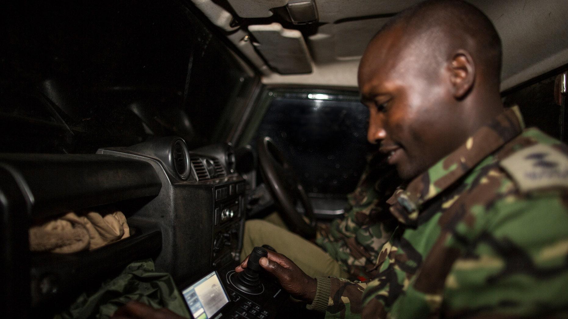 A ranger testing the new mobile FLIR camera unit at the Mara Conservancy at Maasai Mara National Reserve Kenya as part of WWF's Wildlife Crime Technology project (World Wildlife Fund).