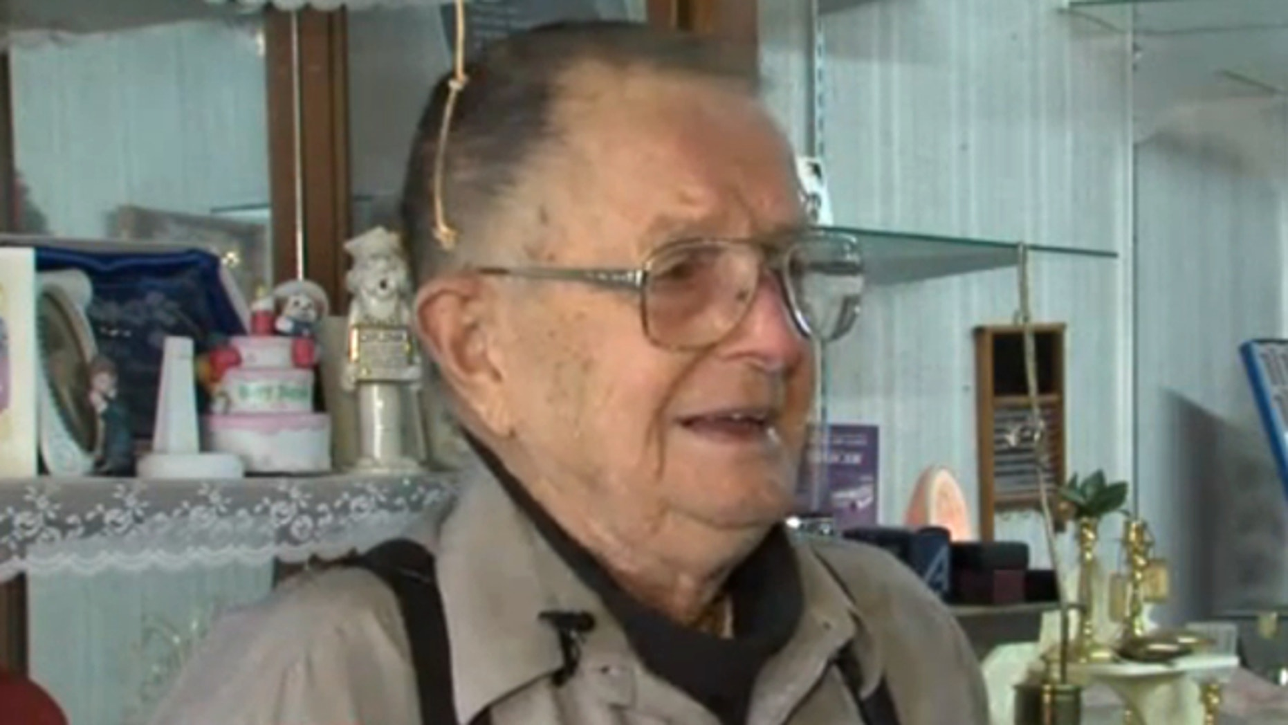 Kenneth Knudson, an 88-year-old World War II veteran, says he was fined and jailed for one night after he failed to produce a plan to fix his office building in downtown Horton, Kan.
